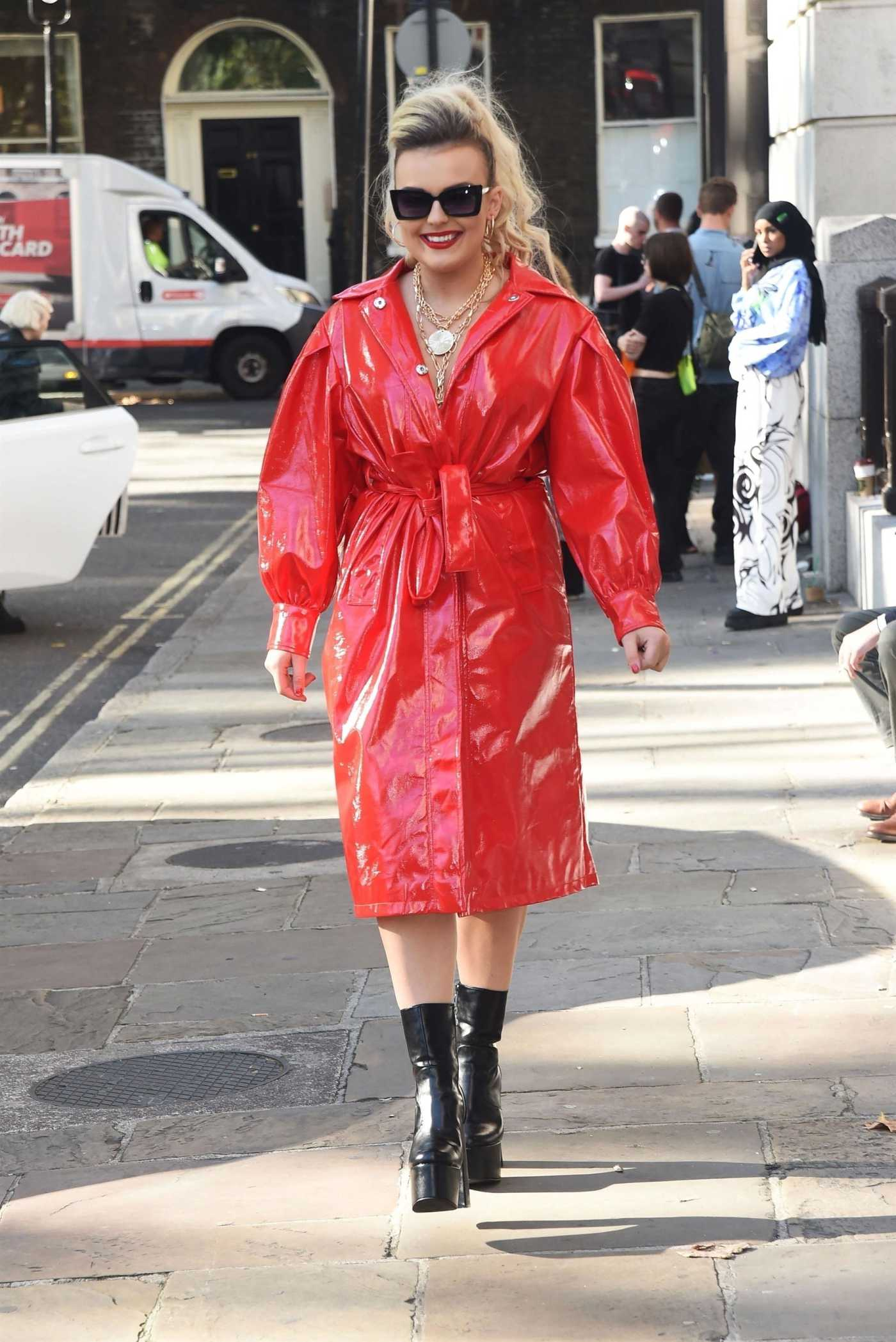 Tallia Storm in a Red Trench Coat Was Seen Out in London 09/13/2019