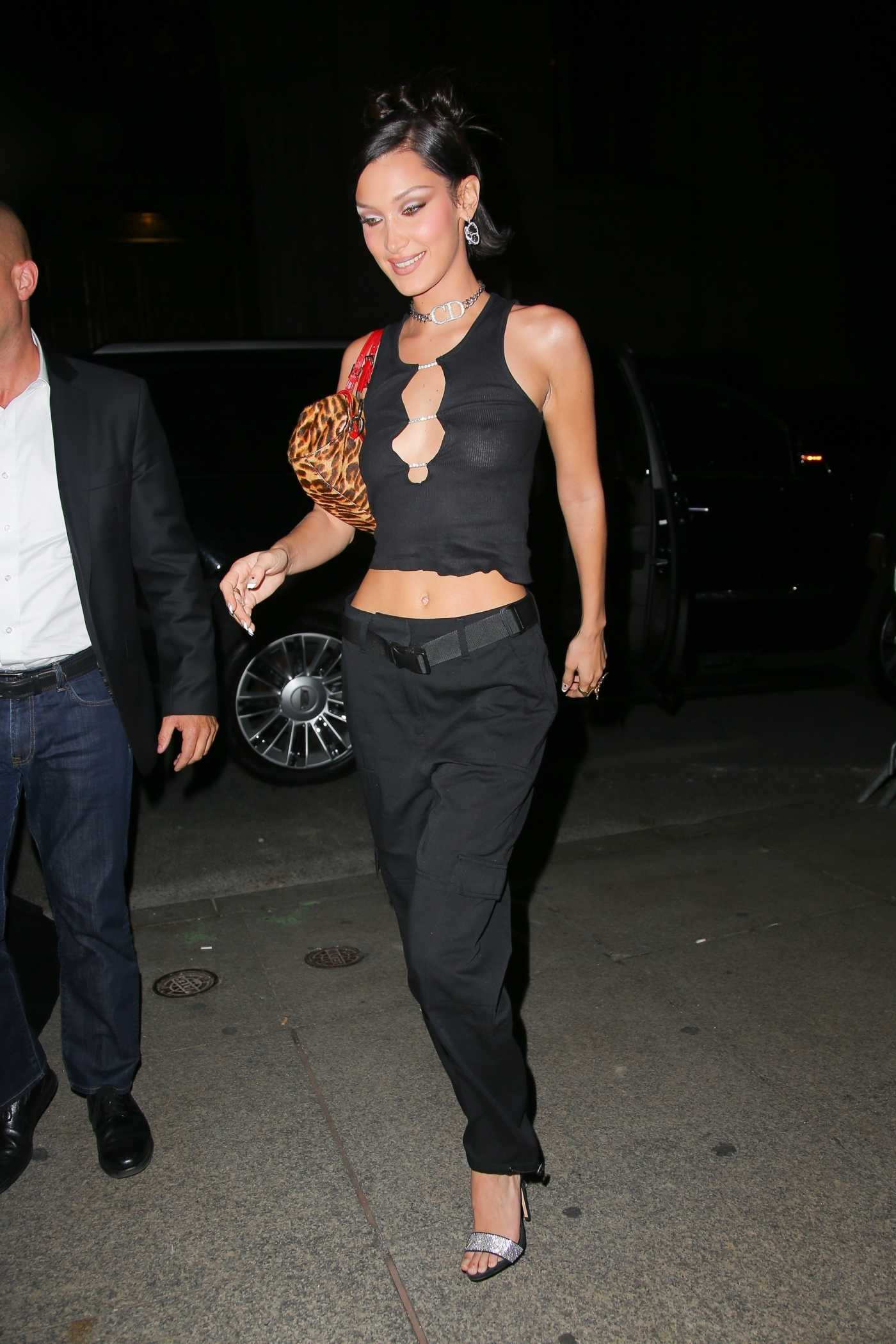 Bella Hadid in a Black Blouse Arrives at L'Avenue at Saks in New York City 10/10/2019