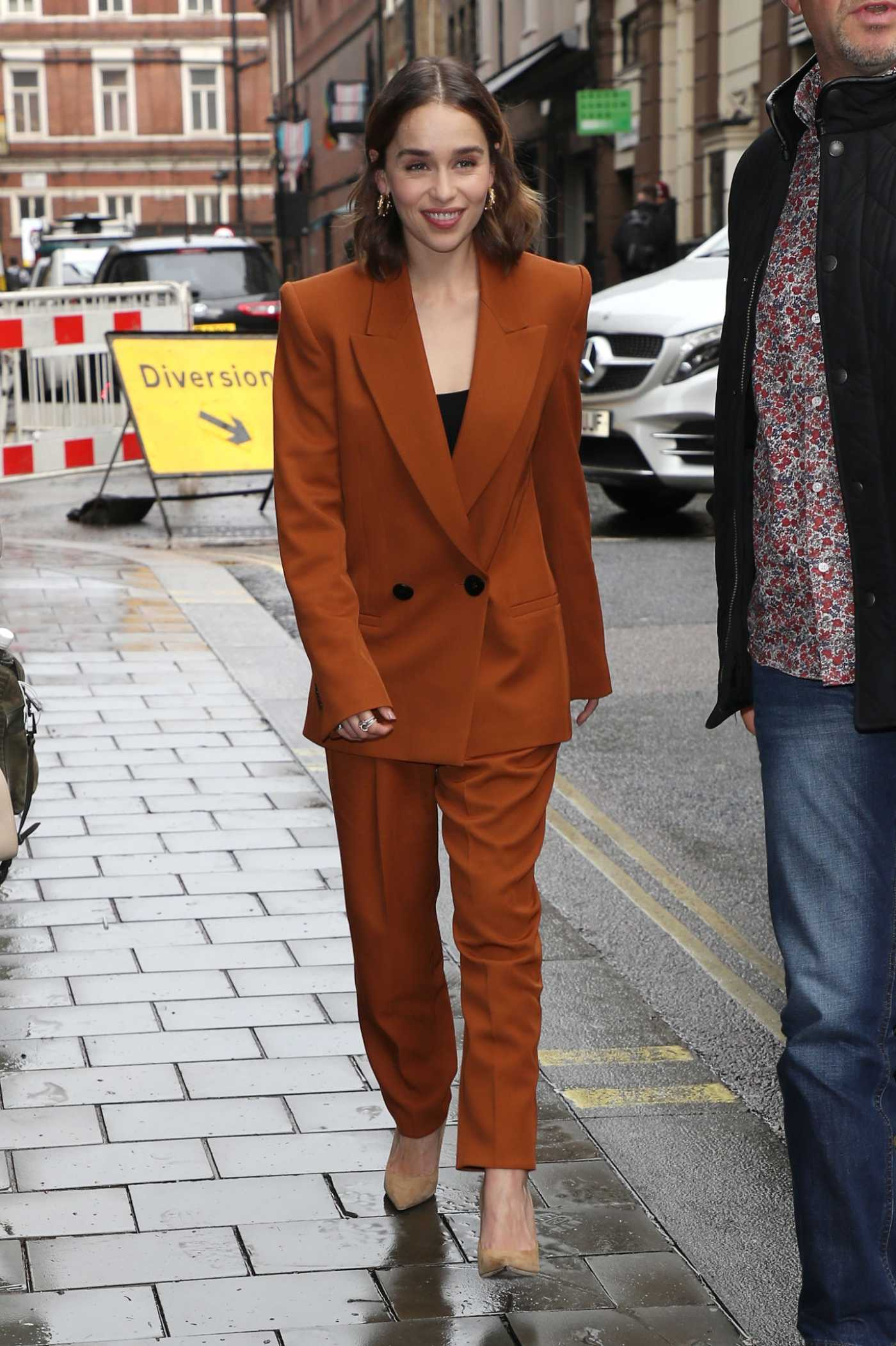 Emilia Clarke in a Brown Suit Arrives at Her Hotel in London 10/23/2019