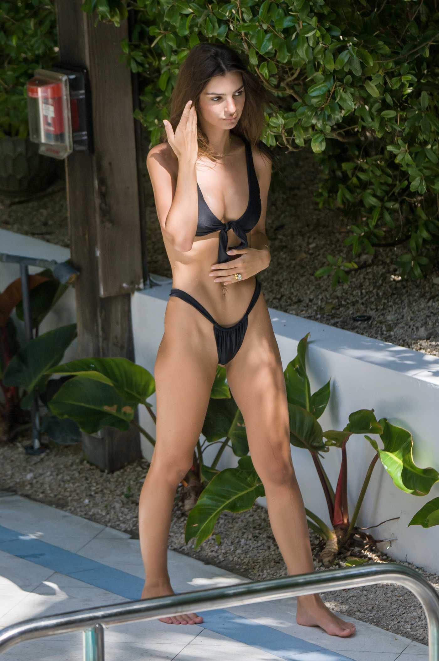 Emily Ratajkowski in a Black Bikini by the Pool in Miami 10/16/2019