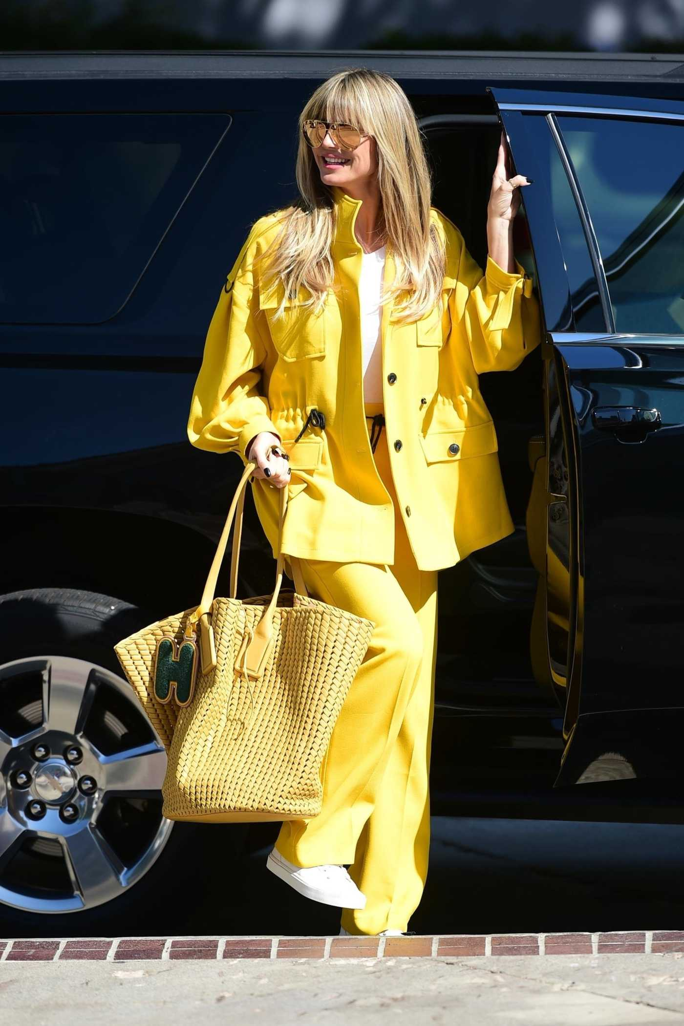 Heidi Klum in a Yellow Suit Arrives at America's Got Talent Finals in Pasadena 10/18/2019
