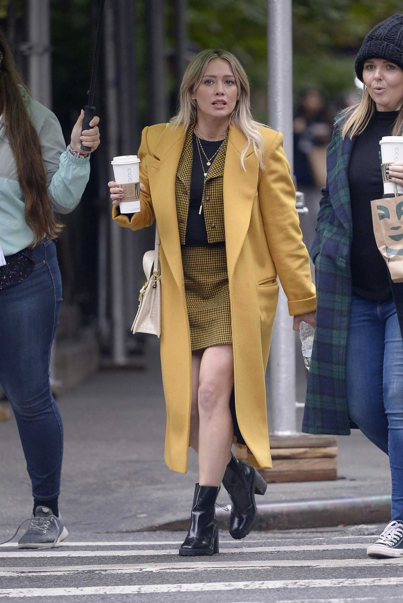 Hilary Duff in a Yellow Coat on the Set of Lizzie McGuire in NY 10/29/2019