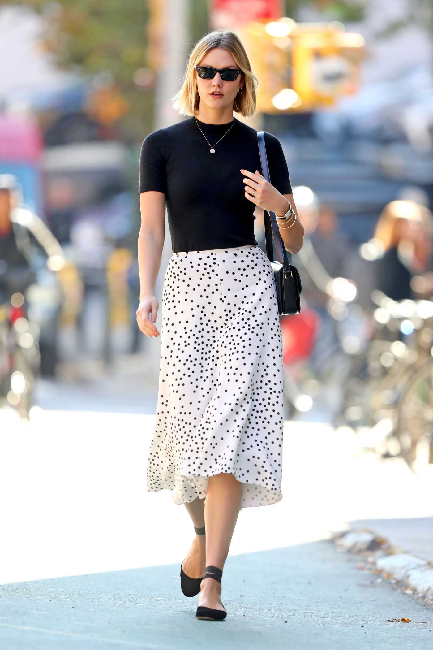 Karlie Kloss in a White Polka Dot Skirt Was Seen Out in NY 10/21/2019