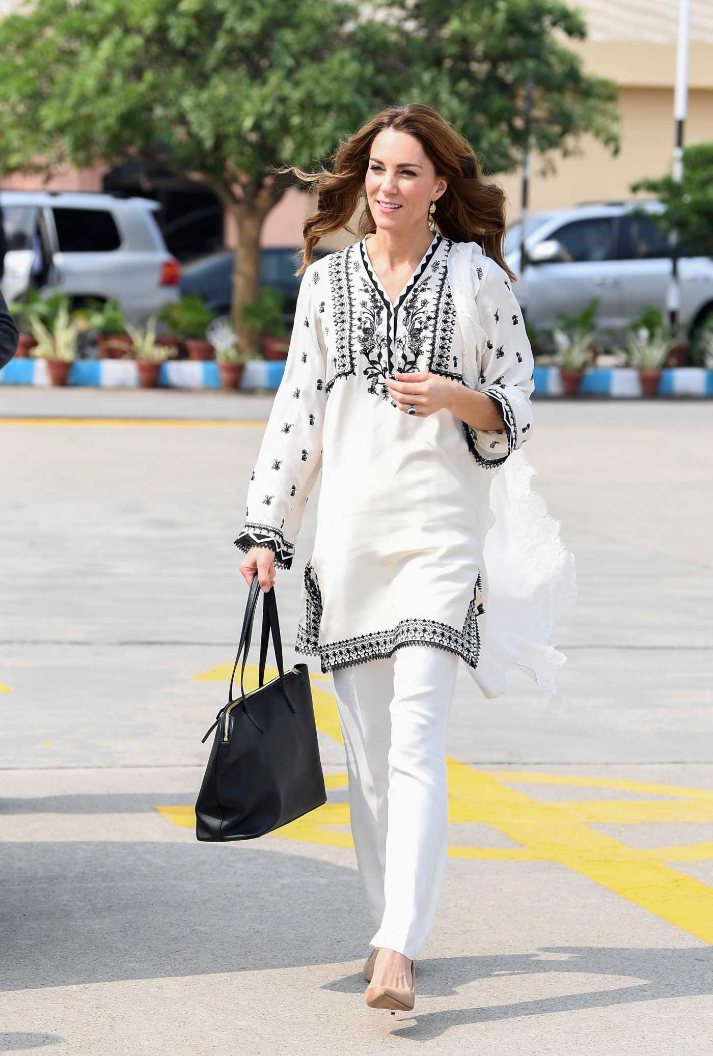 Kate Middleton in a White Pants Arrives at Lahore Airport in Lahore, Pakistan 10/18/2019