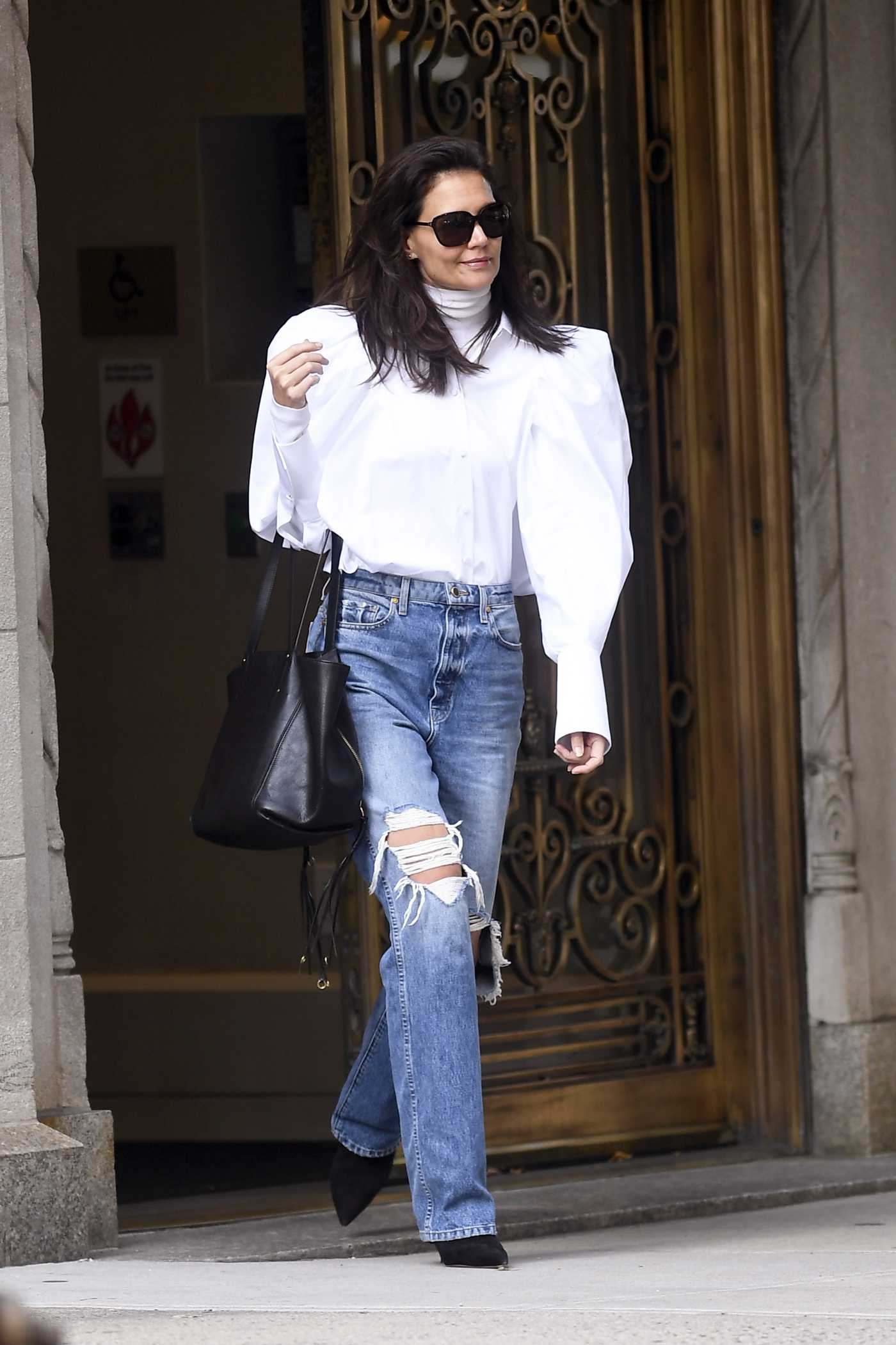 Katie Holmes in a Blue Ripped Jeans Out for a Business Meeting in NYC 10/26/2019