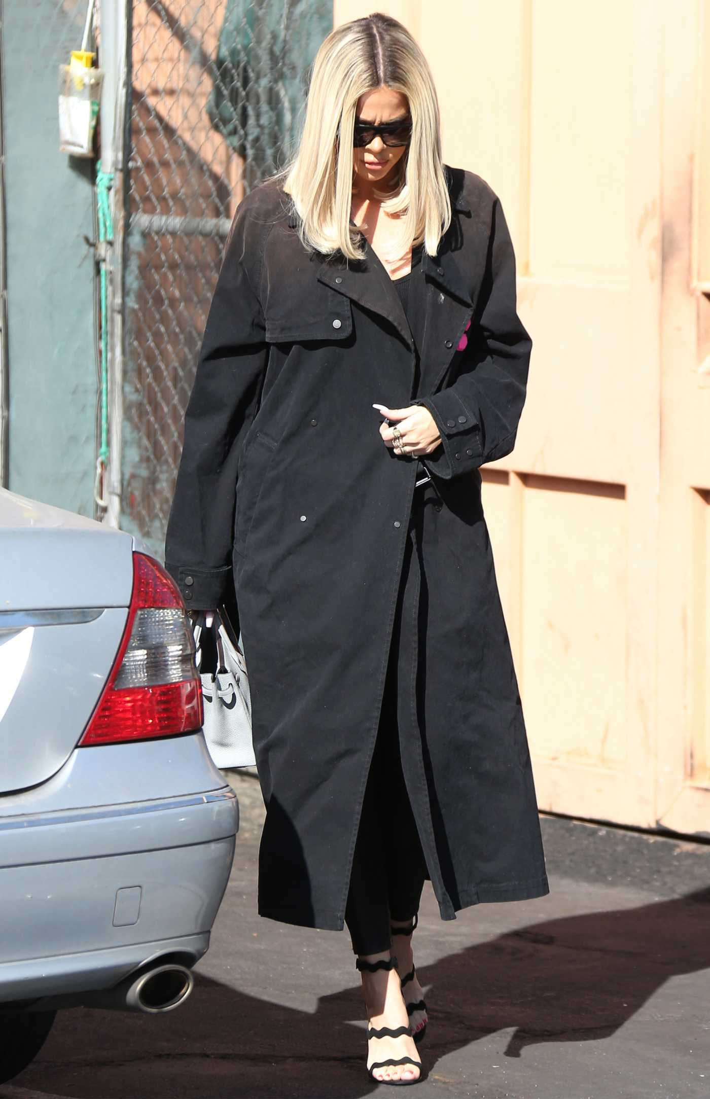 Khloe Kardashian in a Black Trench Coat Leaves Emilio's Trattoria Italian Restaurant in Encino 10/04/2019