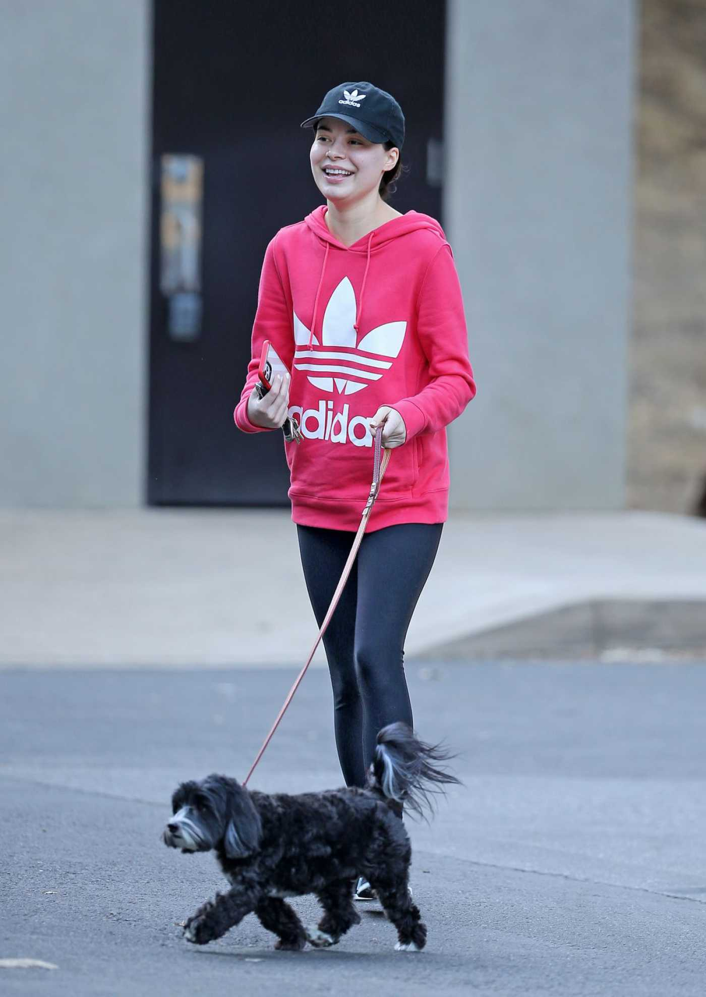 Miranda Cosgrove in a Pink Adidas Hoody Walks Her Dog Out in Los Angeles 10/06/2019