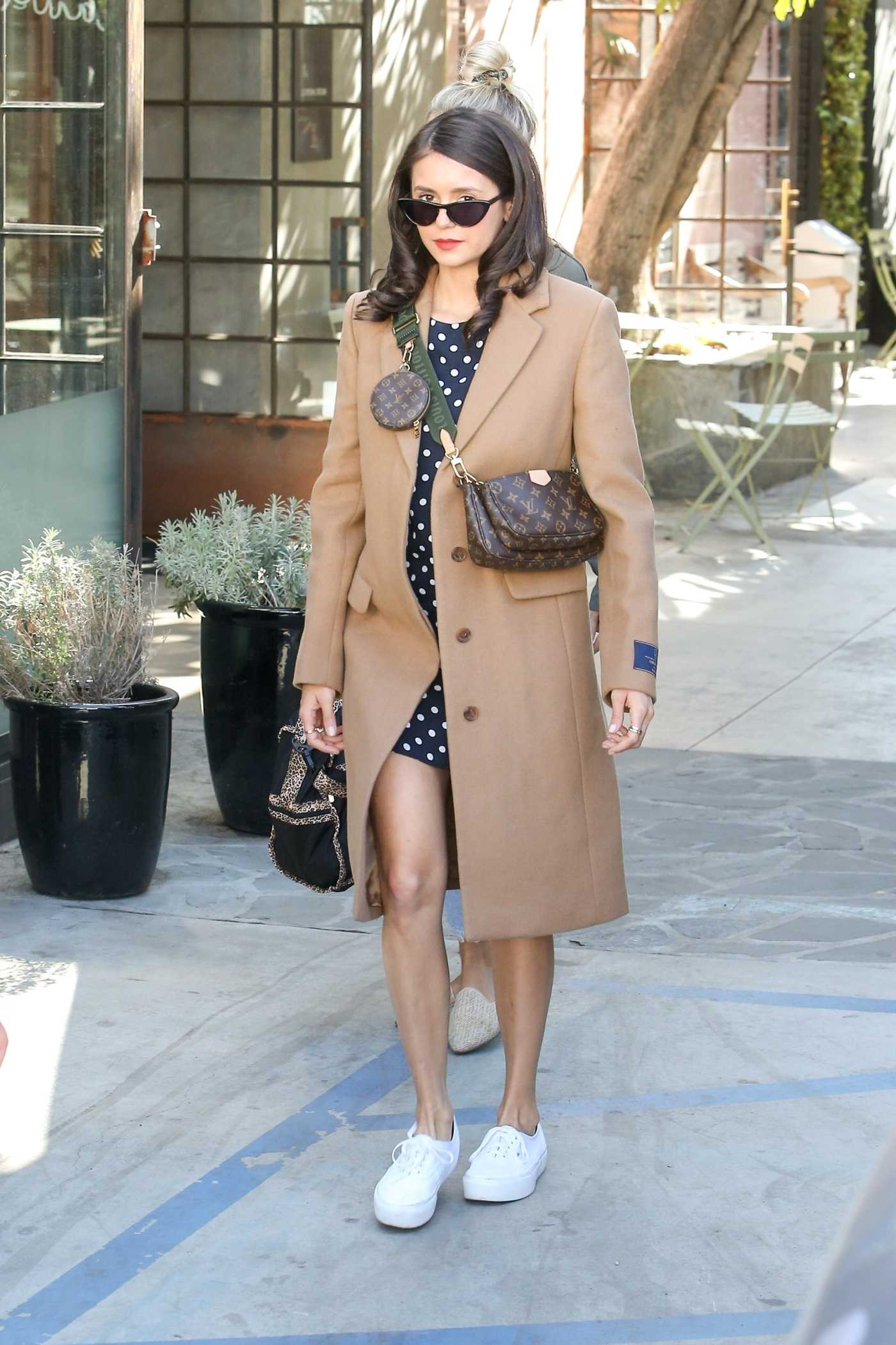 Nina Dobrev in a Beige Coat Leaves Nine Zero One Salon in Los Angeles 10/25/2019