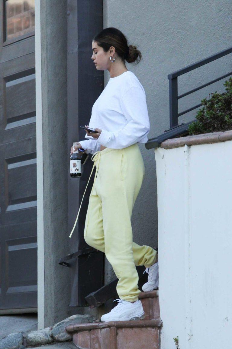 Selena Gomez in a Yellow Sweatpants