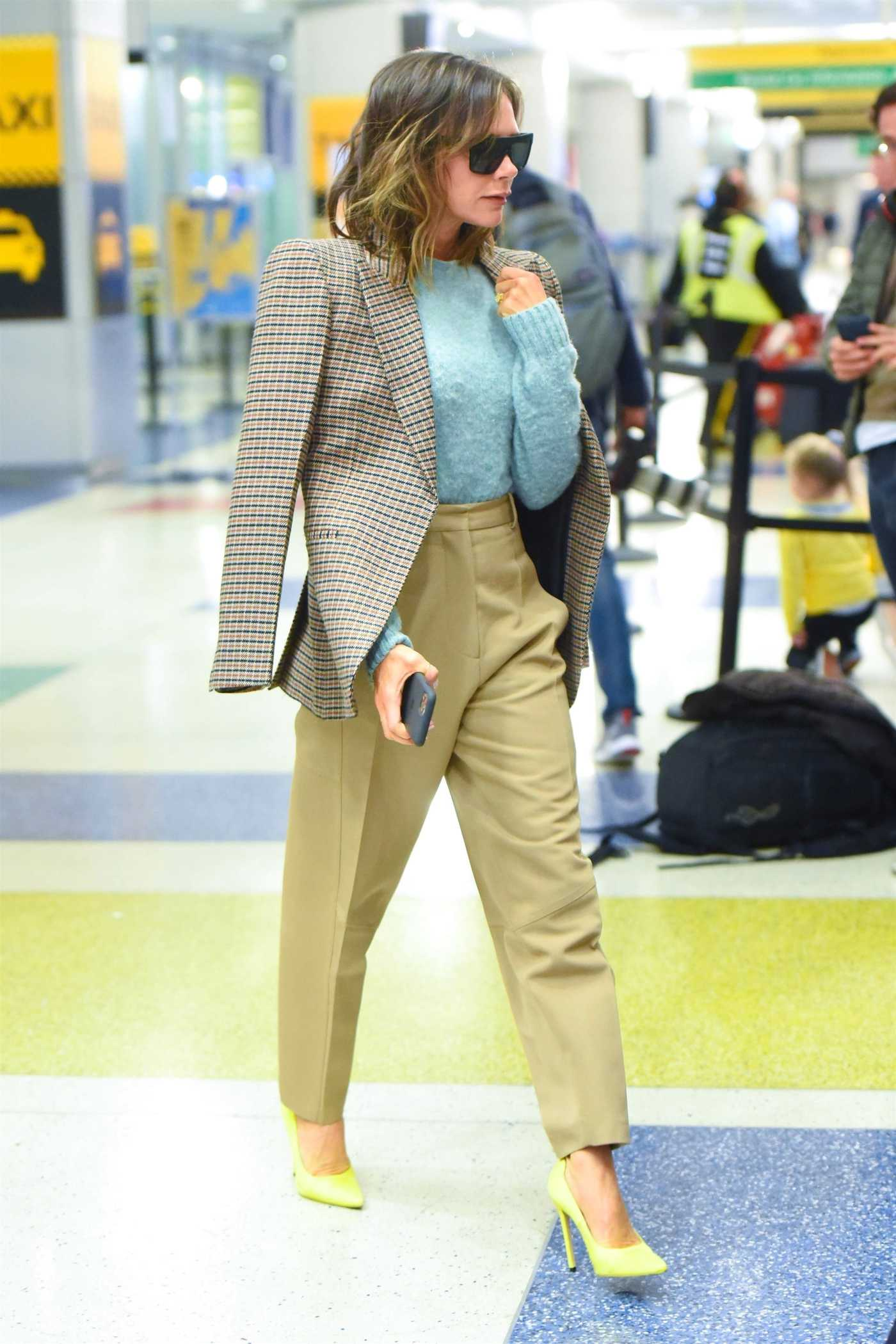 Victoria Beckham in a Beige Pants Arrives at JFK Airport in New York 10/14/2019