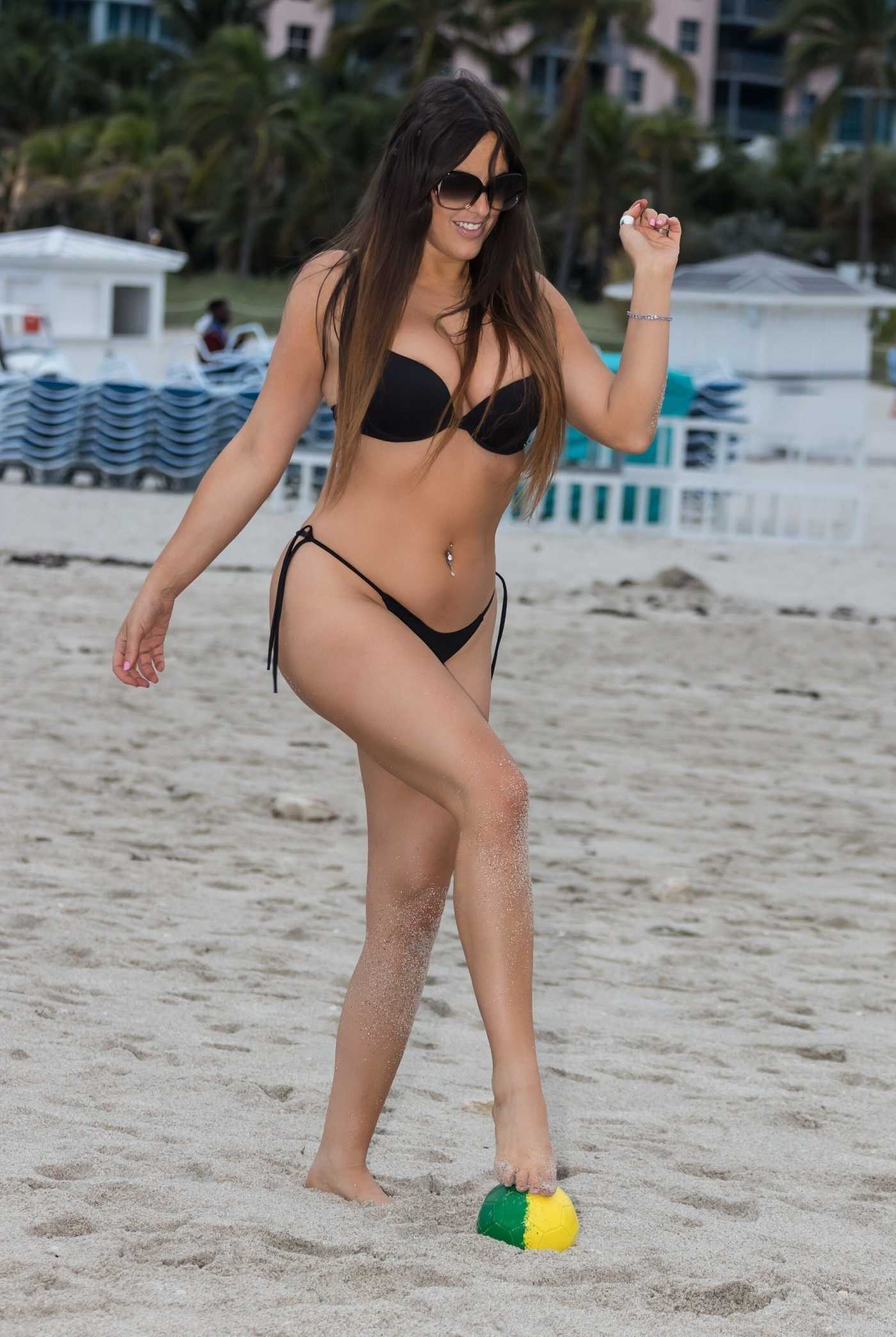 Claudia Romani in a Black Bikini on the Beach in Miami 11/20/2019