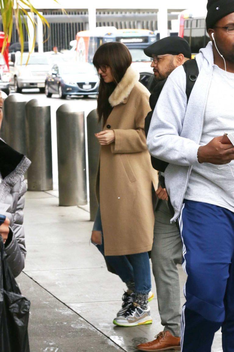 Dakota Johnson in a Beige Coat
