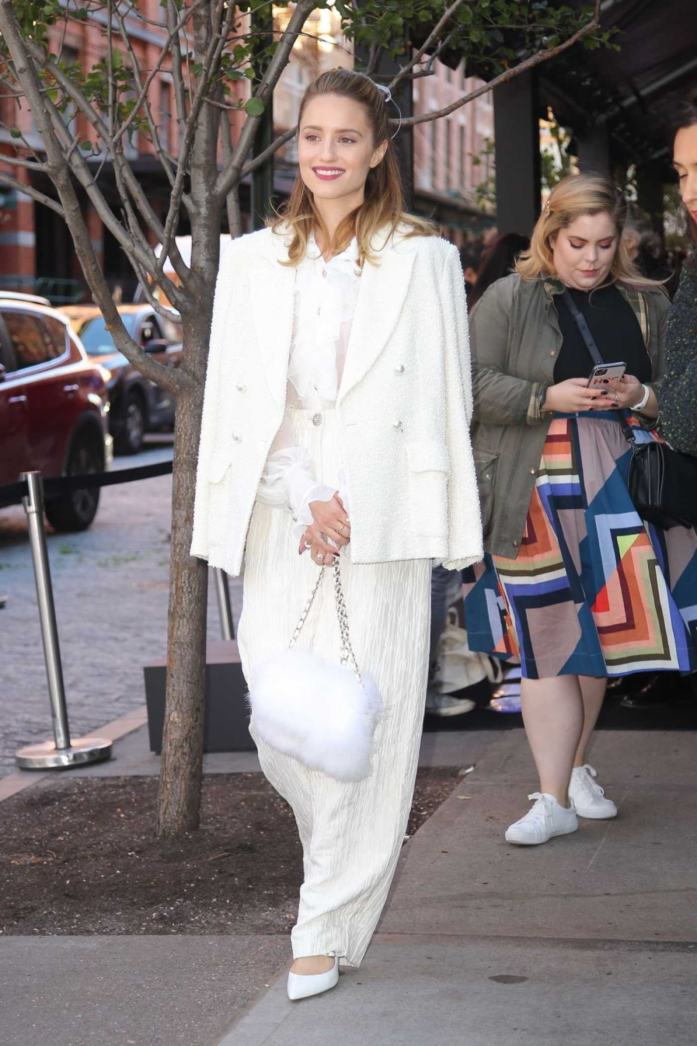 Dianna Agron in a White Suit Arrives at Tribeca Chanel Women's Filmmaker Program Luncheon in NY 11/04/2019