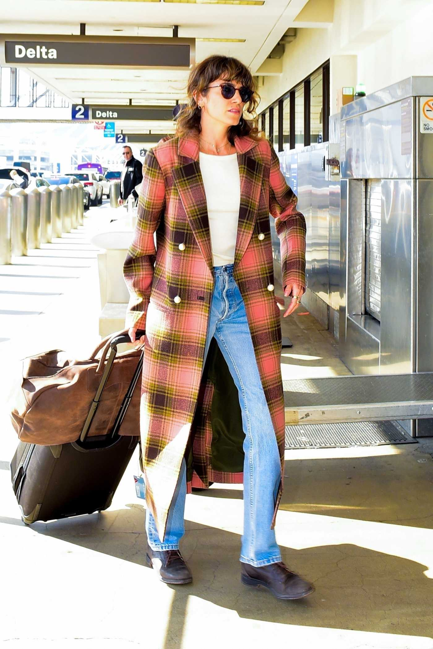 Nikki Reed in a Plaid Coat Arrives at LAX Airport in LA 11/12/2019