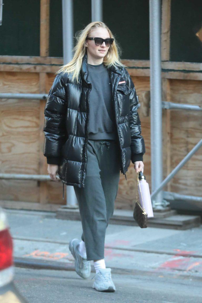 Sophie Turner in a Black Puffer Jacket
