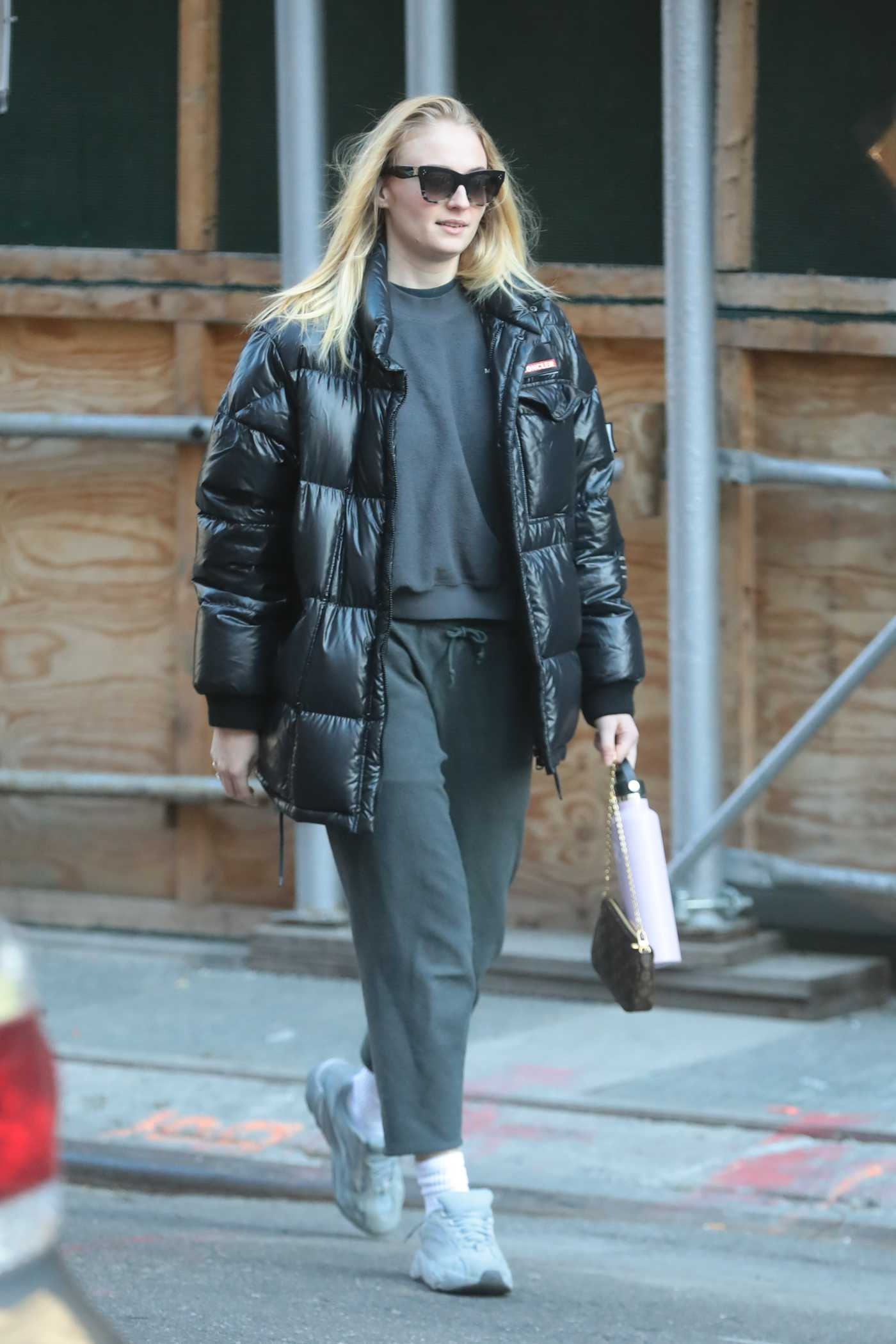 Sophie Turner in a Black Puffer Jacket Was Seen Out in NYC 11/29/2019
