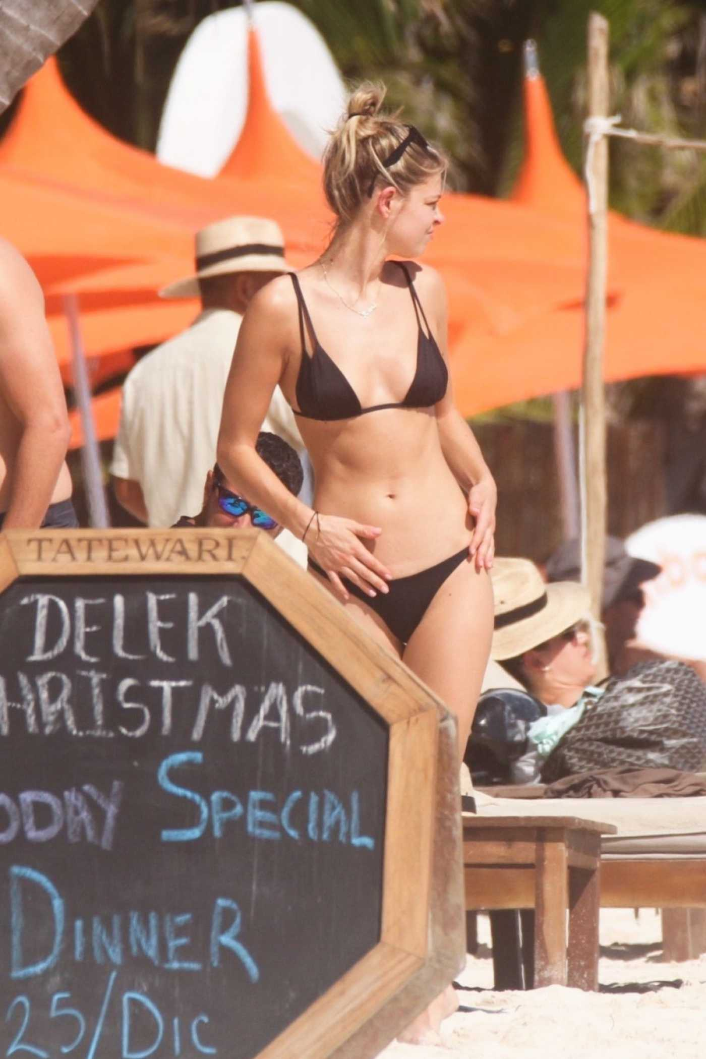 Danielle Knudson in a Black Bikini on the Beach in Tulum 12/25/2019