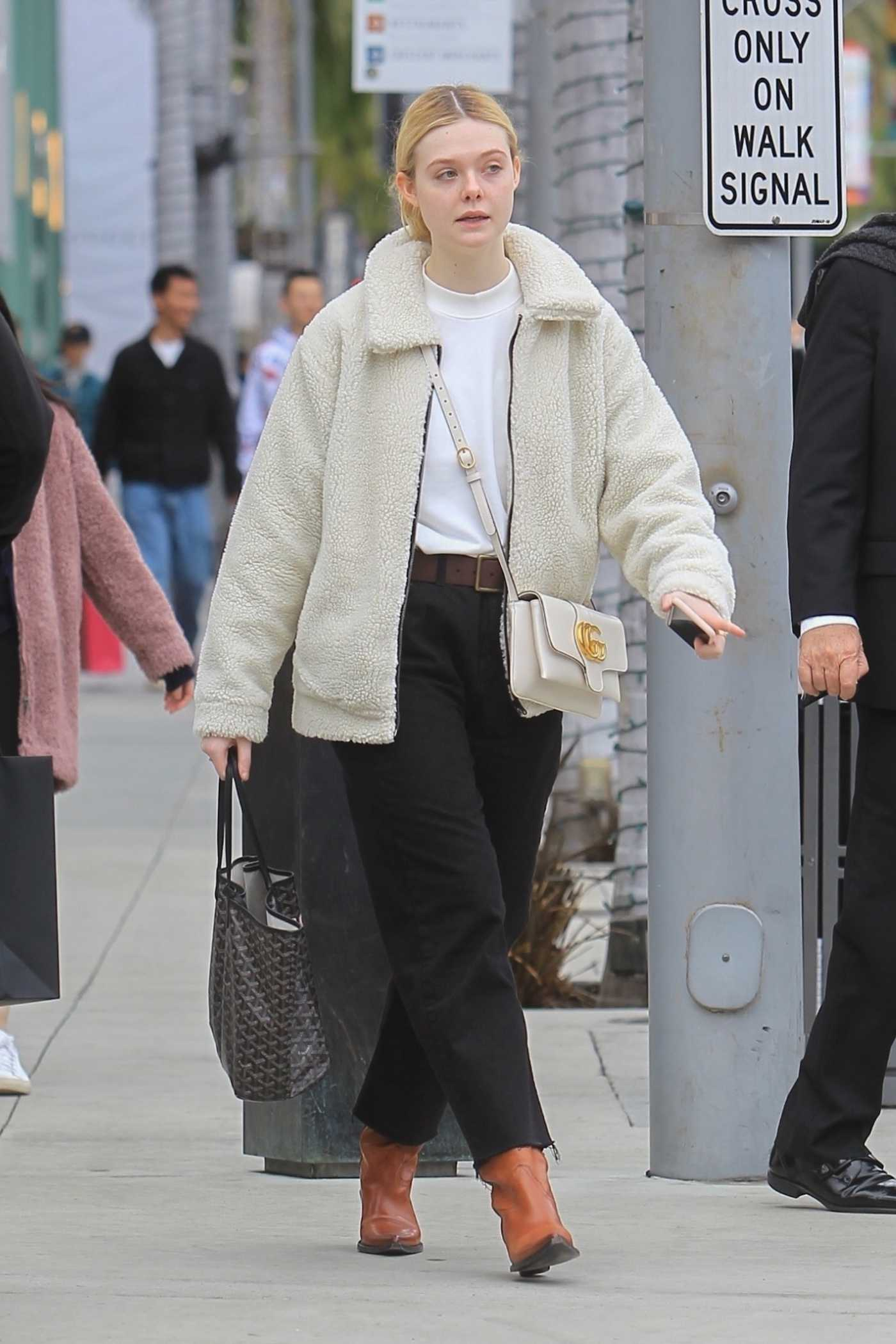 Elle Fanning in a Brown Boots Was Seen Out in Beverly Hills 12/23/2019