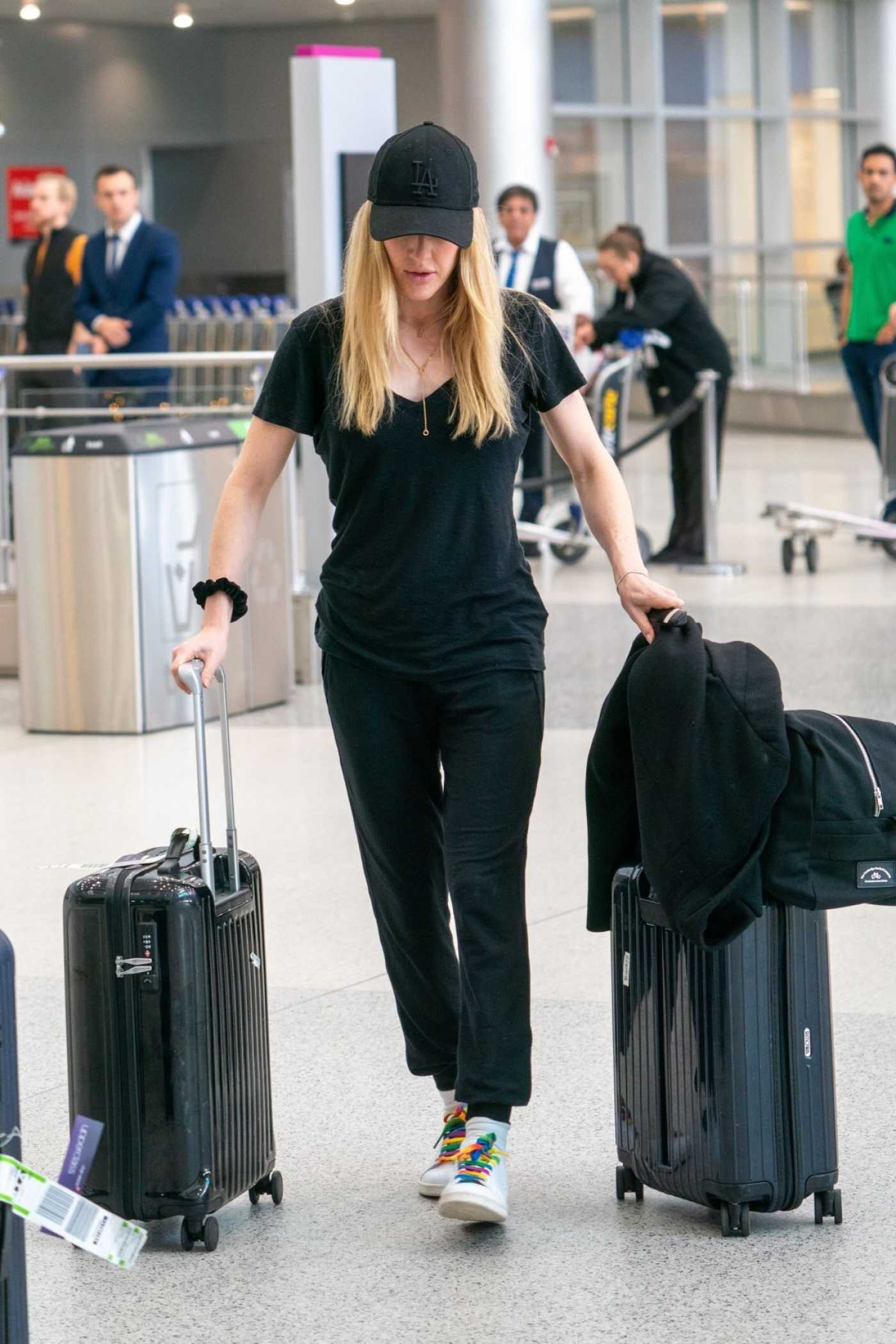 Ellie Goulding in a Black Cap Arrives at Miami International Airport in Miami 12/29/2019