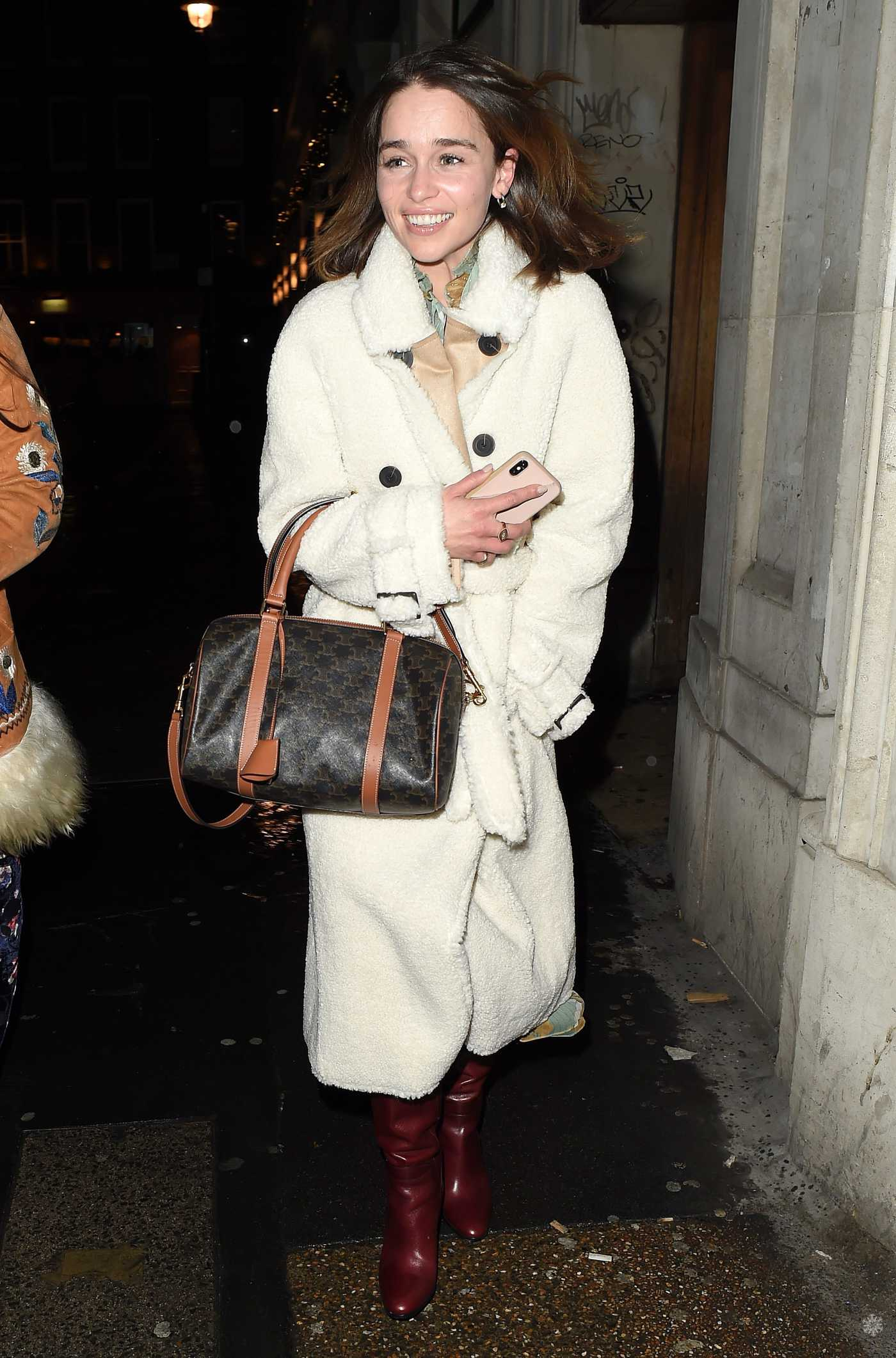 Emilia Clarke in a White Fur Coat Leaves a Restaurant with a Friend in London 12/13/2019