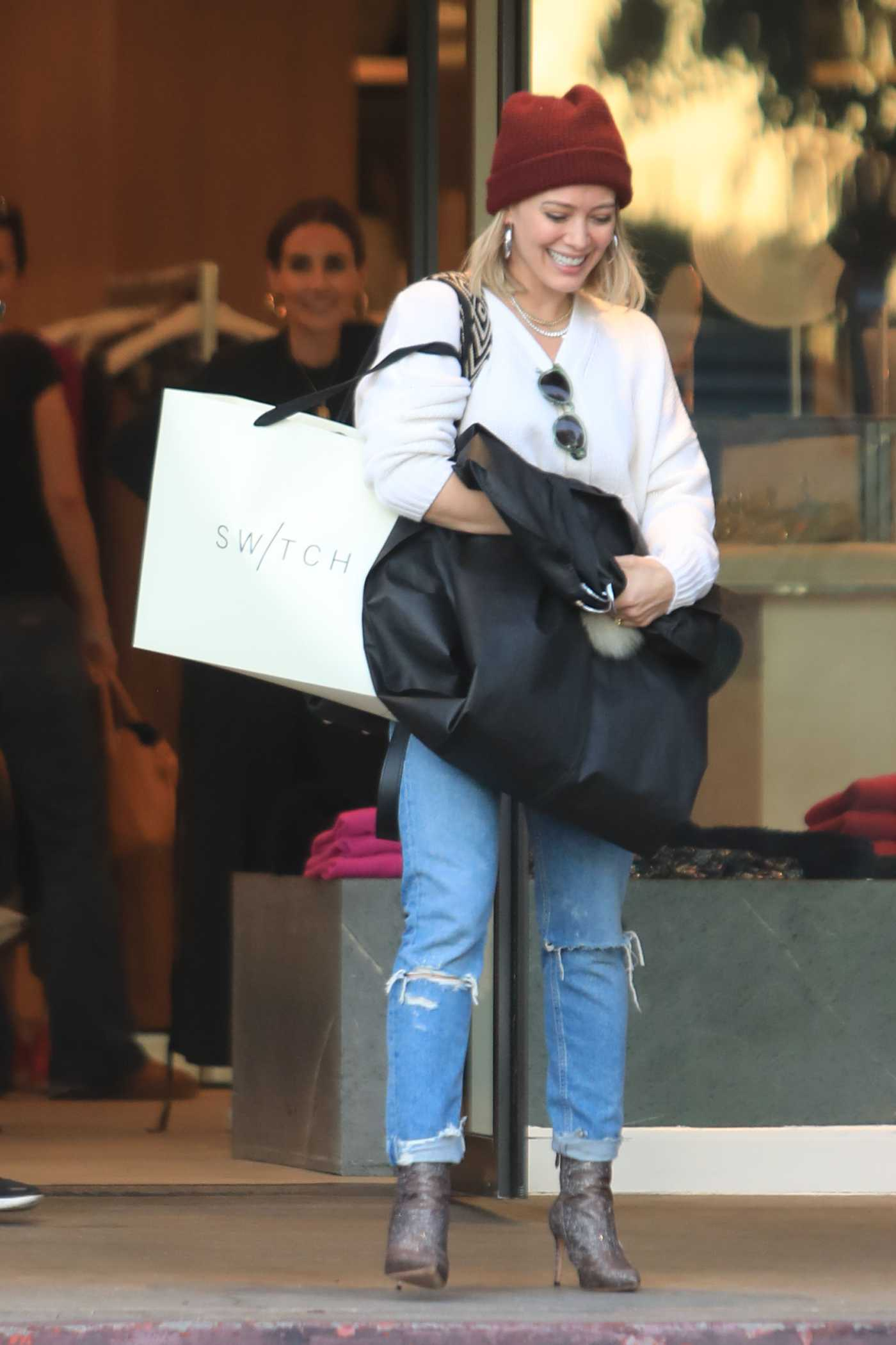Hilary Duff in a Blue Ripped Jeans Out for Christmas Shopping in LA 12/09/2019