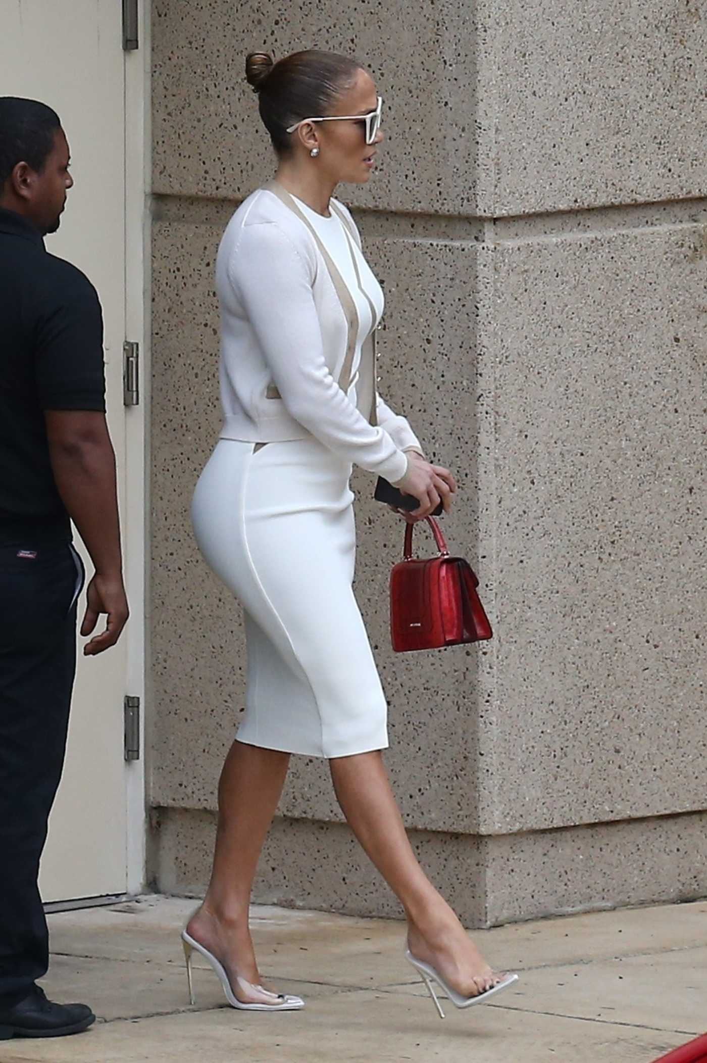 Jennifer Lopez in a White Dress Leaves a Graduation Party at the University of Miami in Miami 12/12/2019