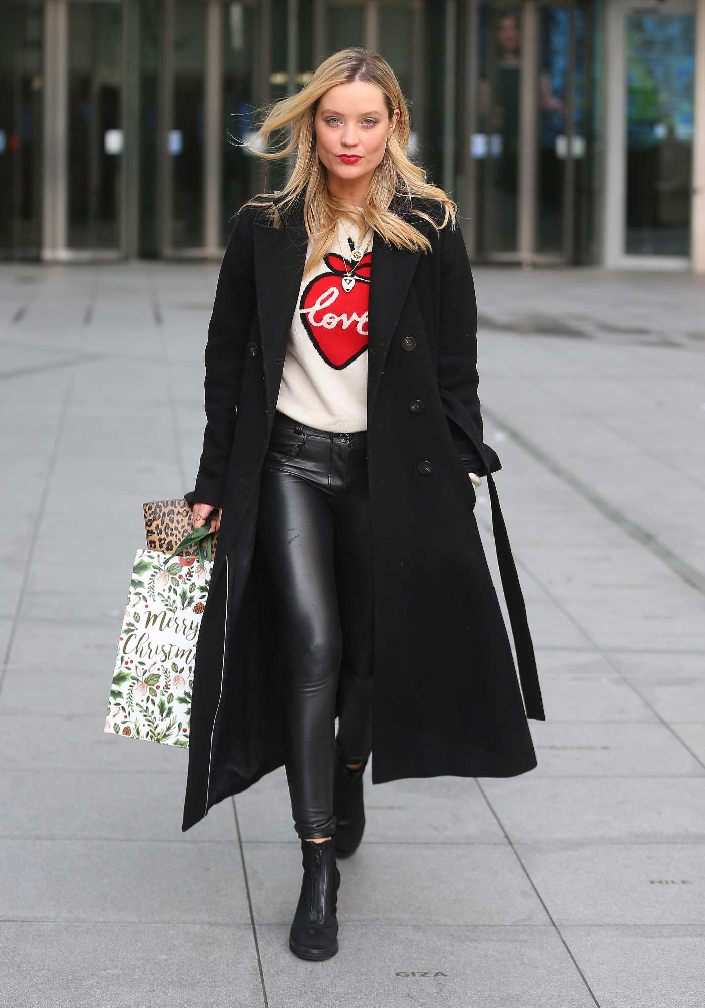 Laura Whitmore in a Black Coat Leaves BBC Radio in London 12/22/2019