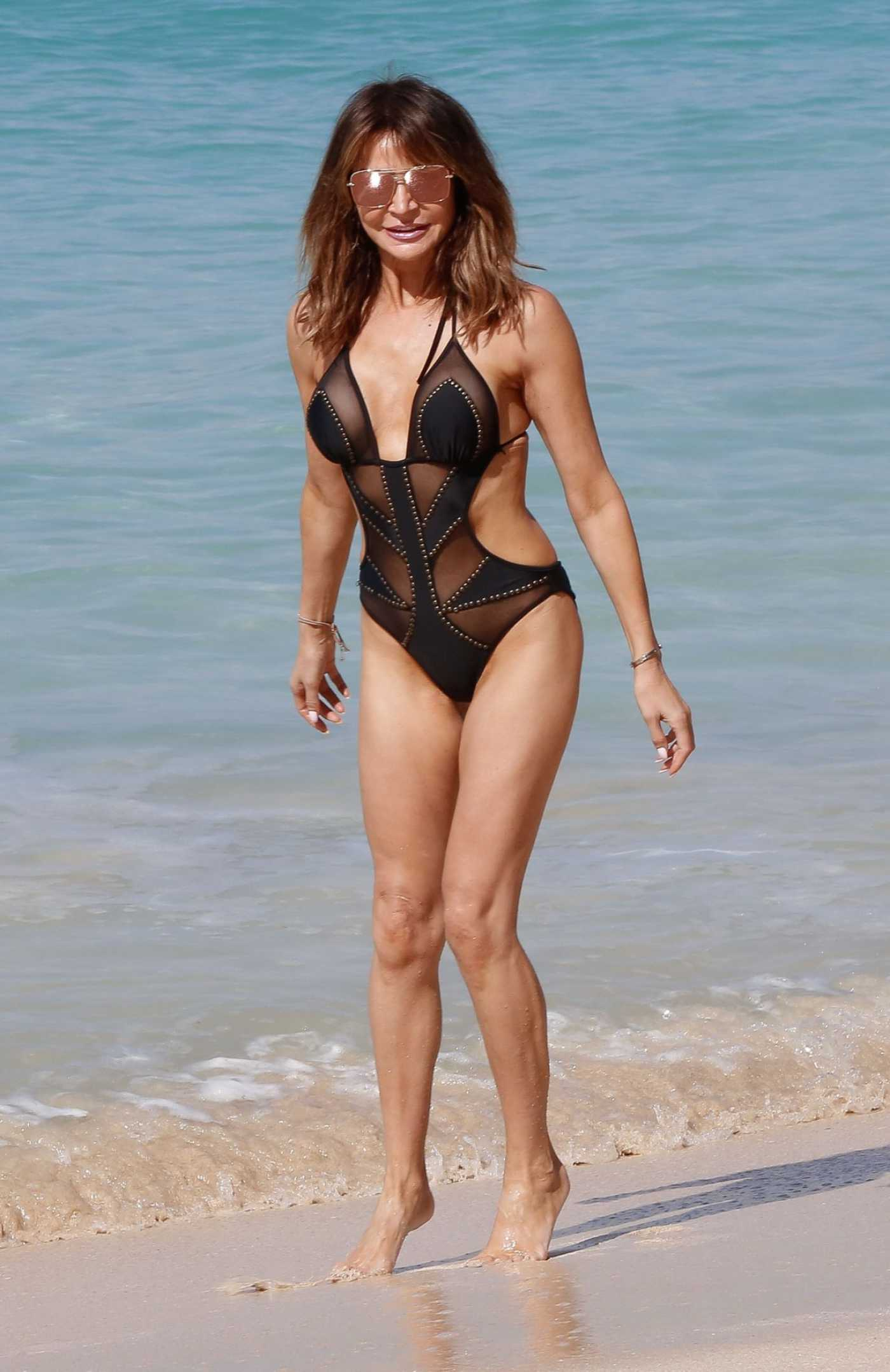 Lizzie Cundy in a Black Swimsuit on the Beach in Barbados 12/30/2019