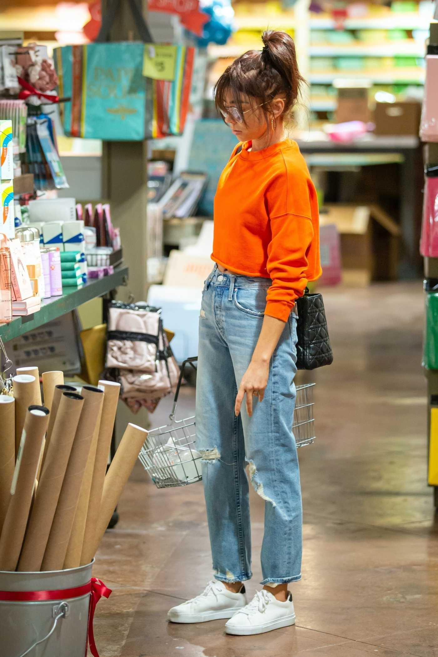 Sarah Hyland in an Orange Cropped Sweatshirt Goes Shopping in Studio City 12/22/2019