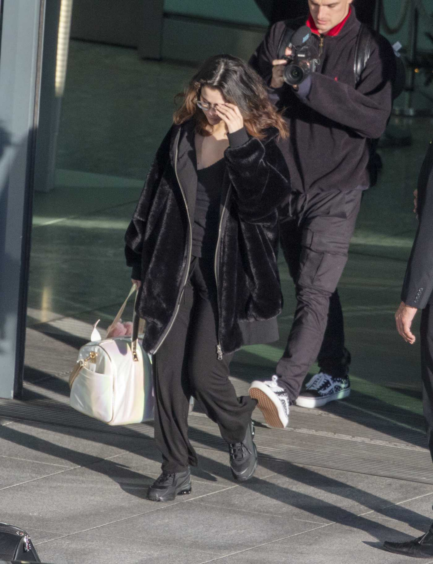 Selena Gomez in a Black Fur Coat Arrives at Heatrow Airport in London 12/02/2019