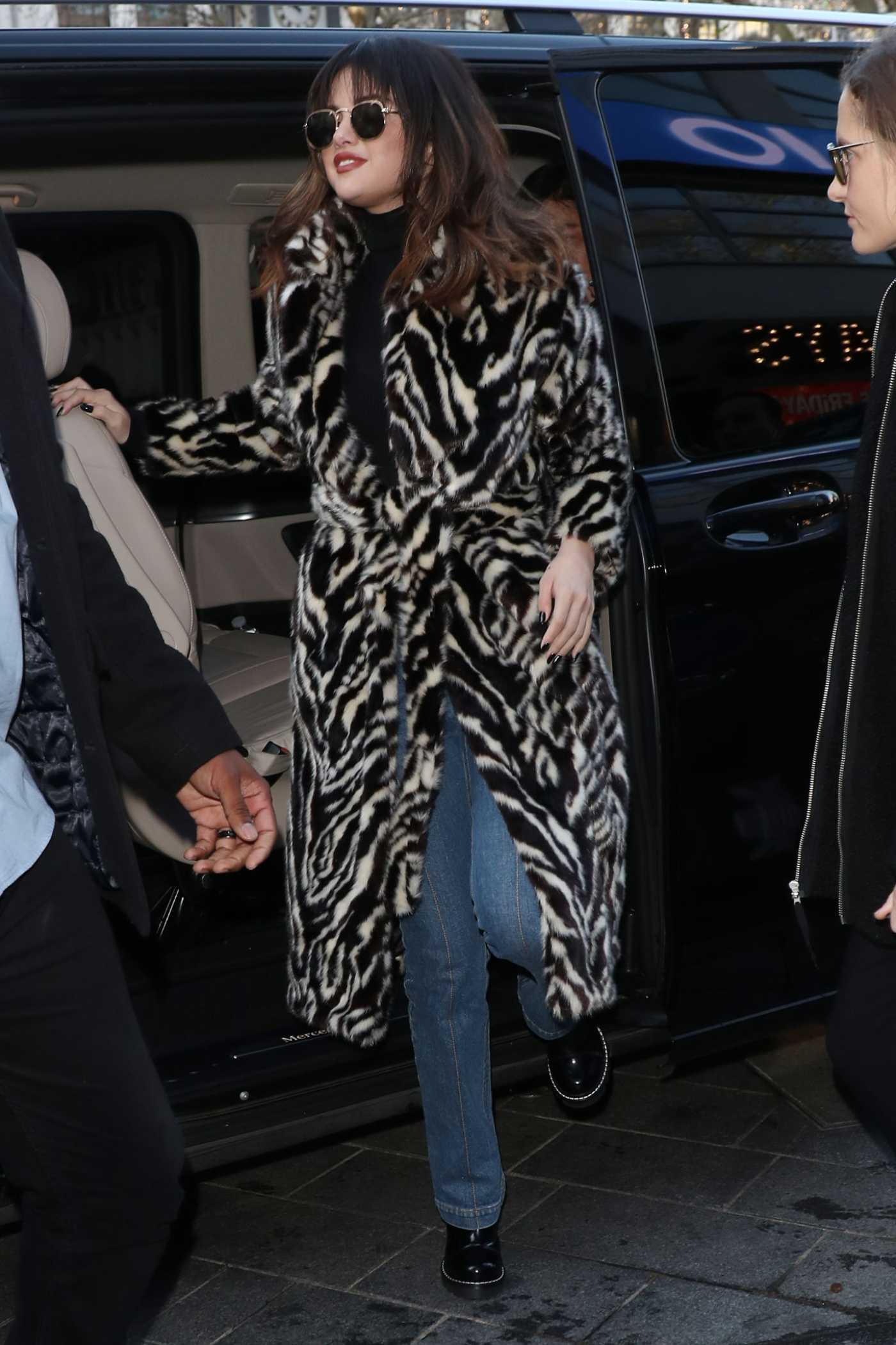 Selena Gomez in a Leopard Print Fur Coat Arriving at Capital Breakfast Radio Studios in London 12/11/2019