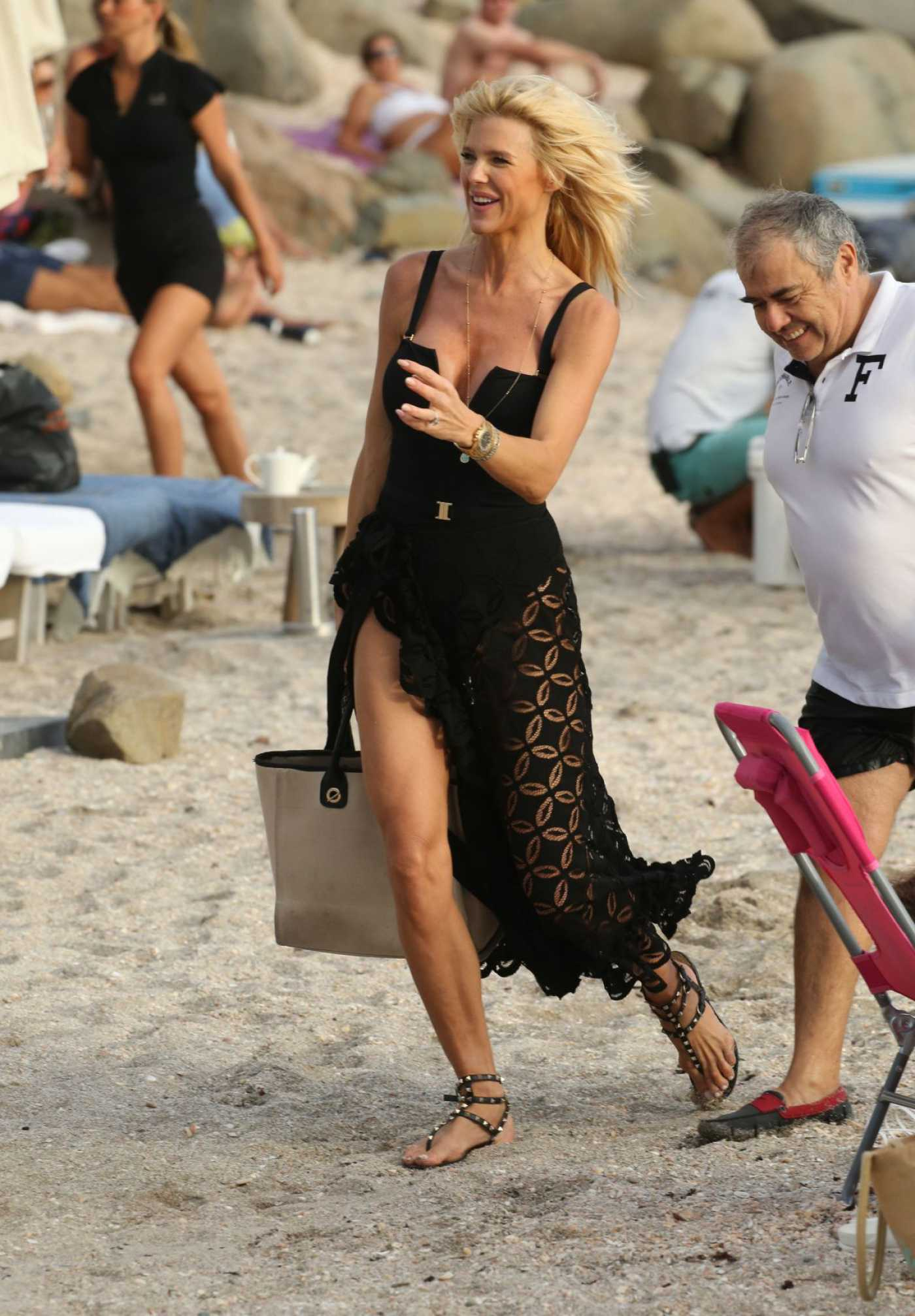 Victoria Silvstedt in a Black Dress on the Beach in St. Barth 12/29/2019