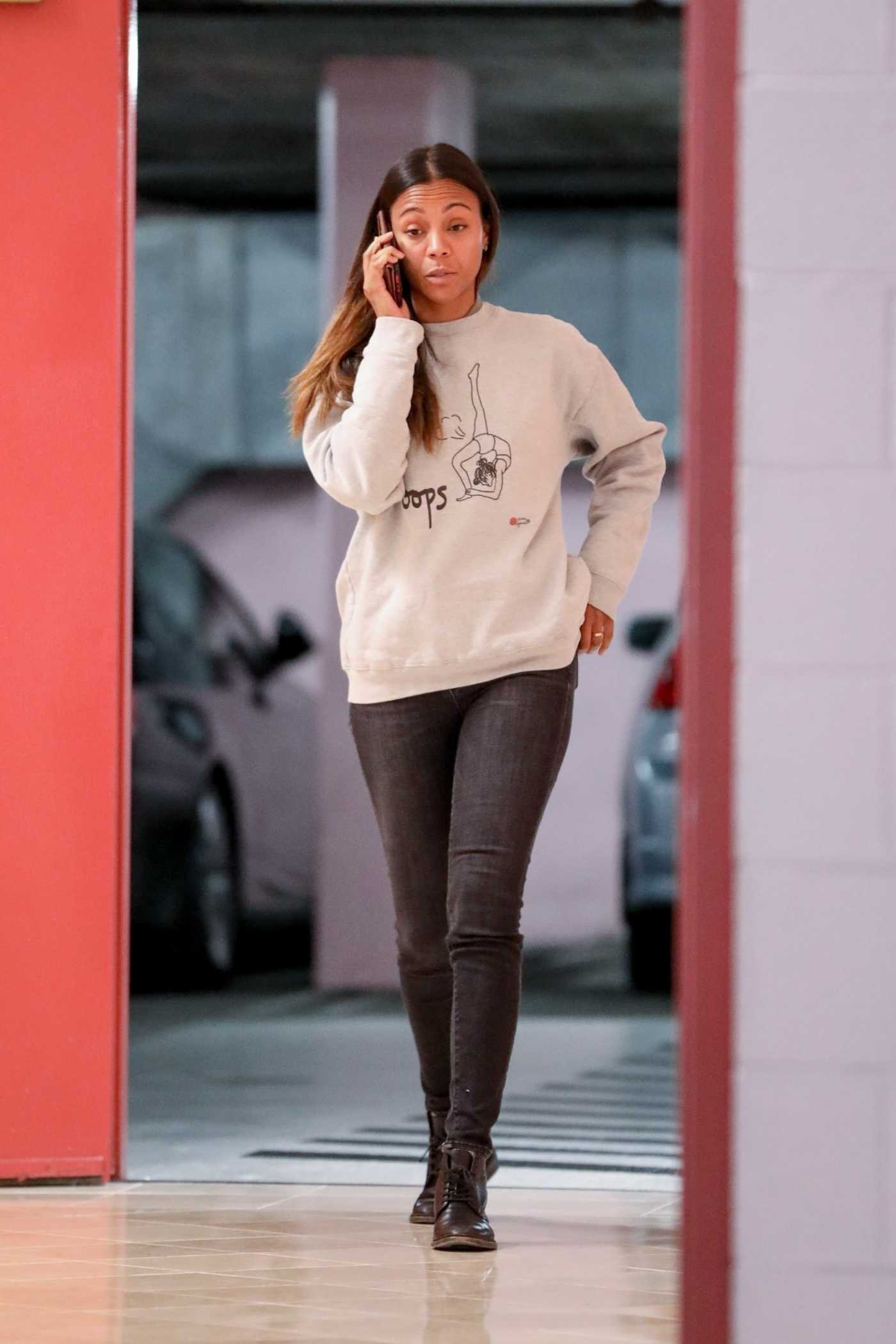 Zoe Saldana in a Gray Sweatshirt Arrives at a Medical Building in Beverly Hills 12/18/2019