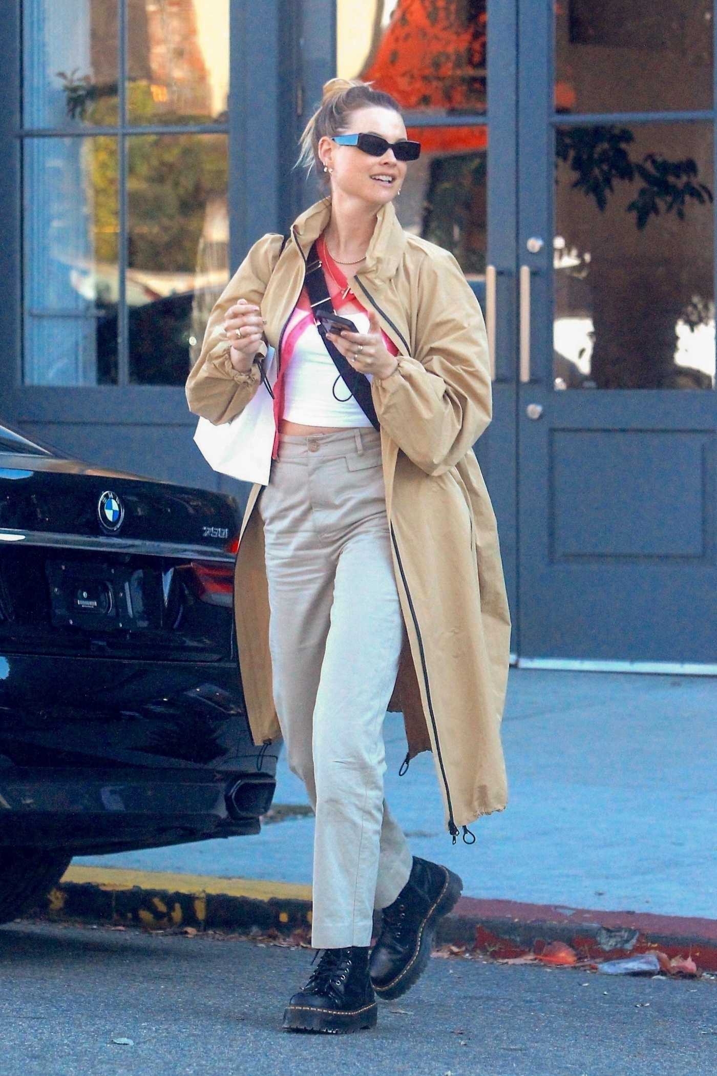 Behati Prinsloo in a Beige Trench Coat Goes Shopping in West Hollywood 01/28/2020