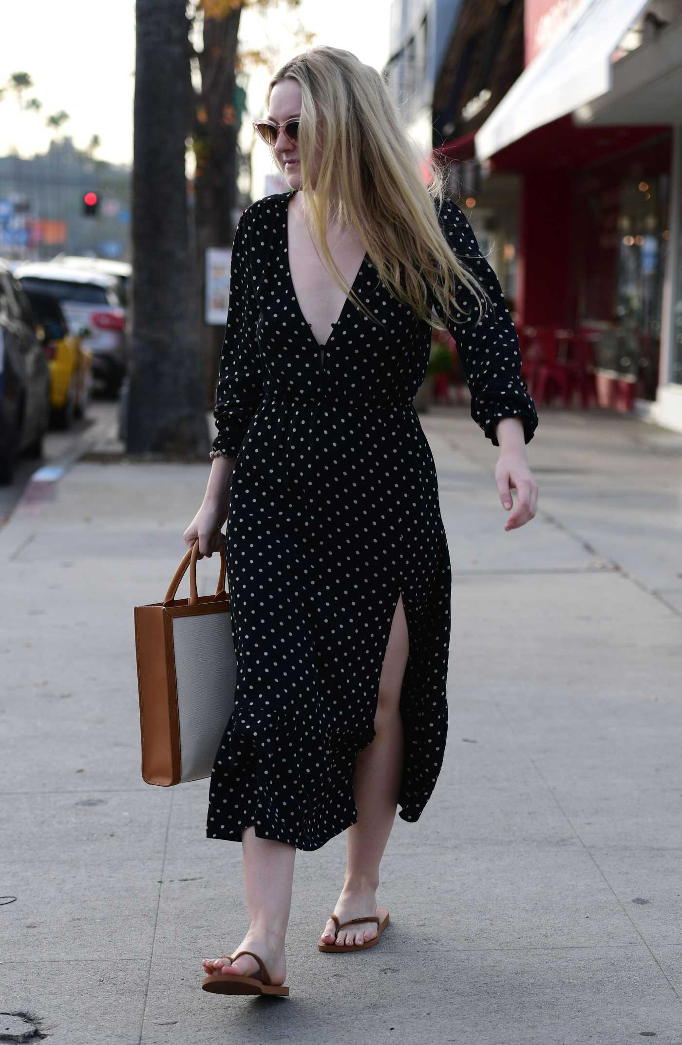 Dakota Fanning in a Black Polka Dot Dress Goes Shopping in LA 01/03/2020