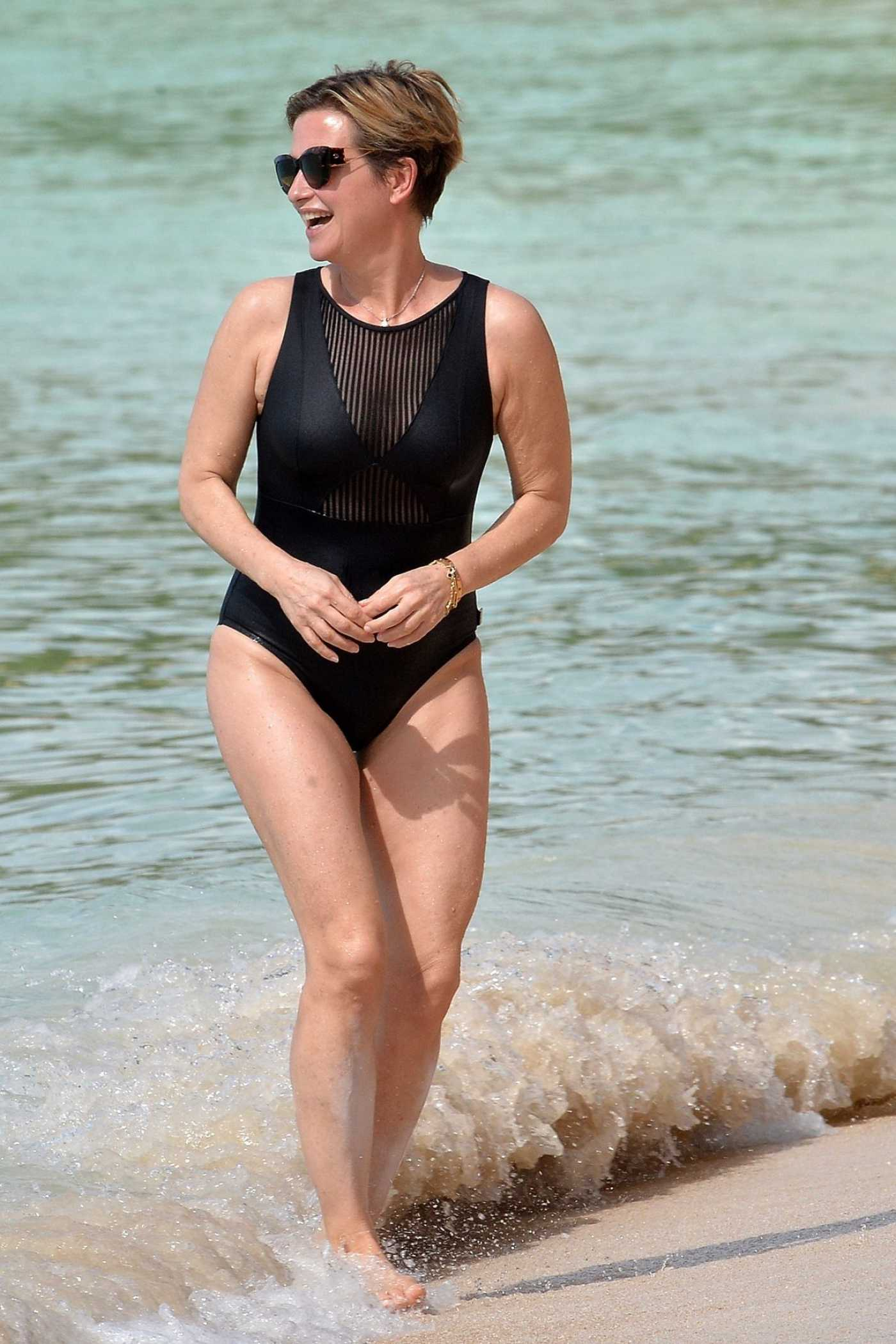 Emma Forbes in a Black Swimsuit on the Beach in Barbados 01/01/2020