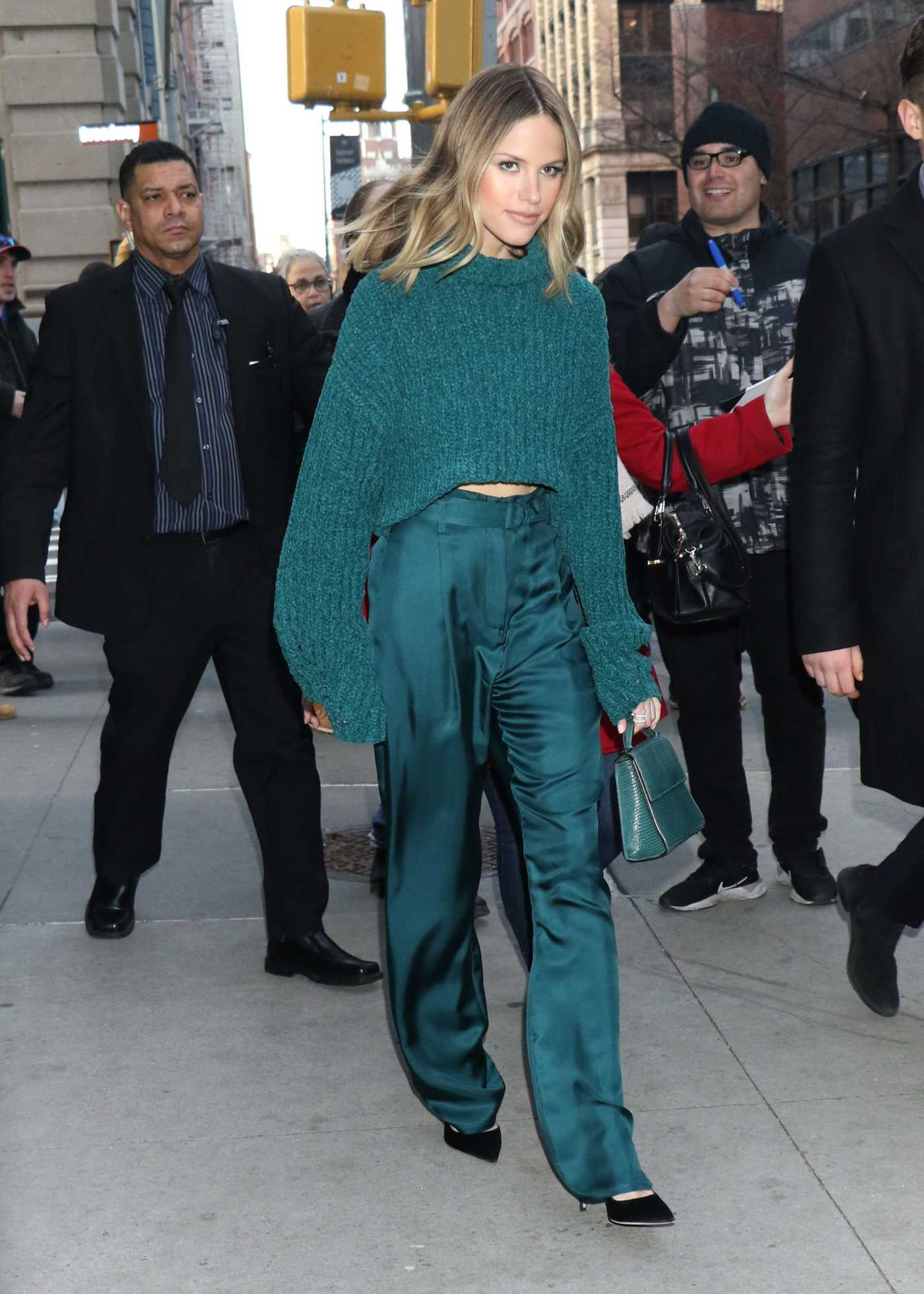 Halston Sage in a Green Sweater Leaves AOL Build Series in NY 01/15/2020