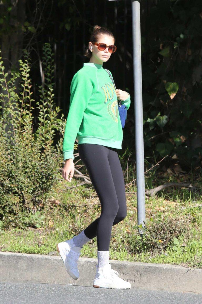 Kaia Gerber in a Green Sweatshirt