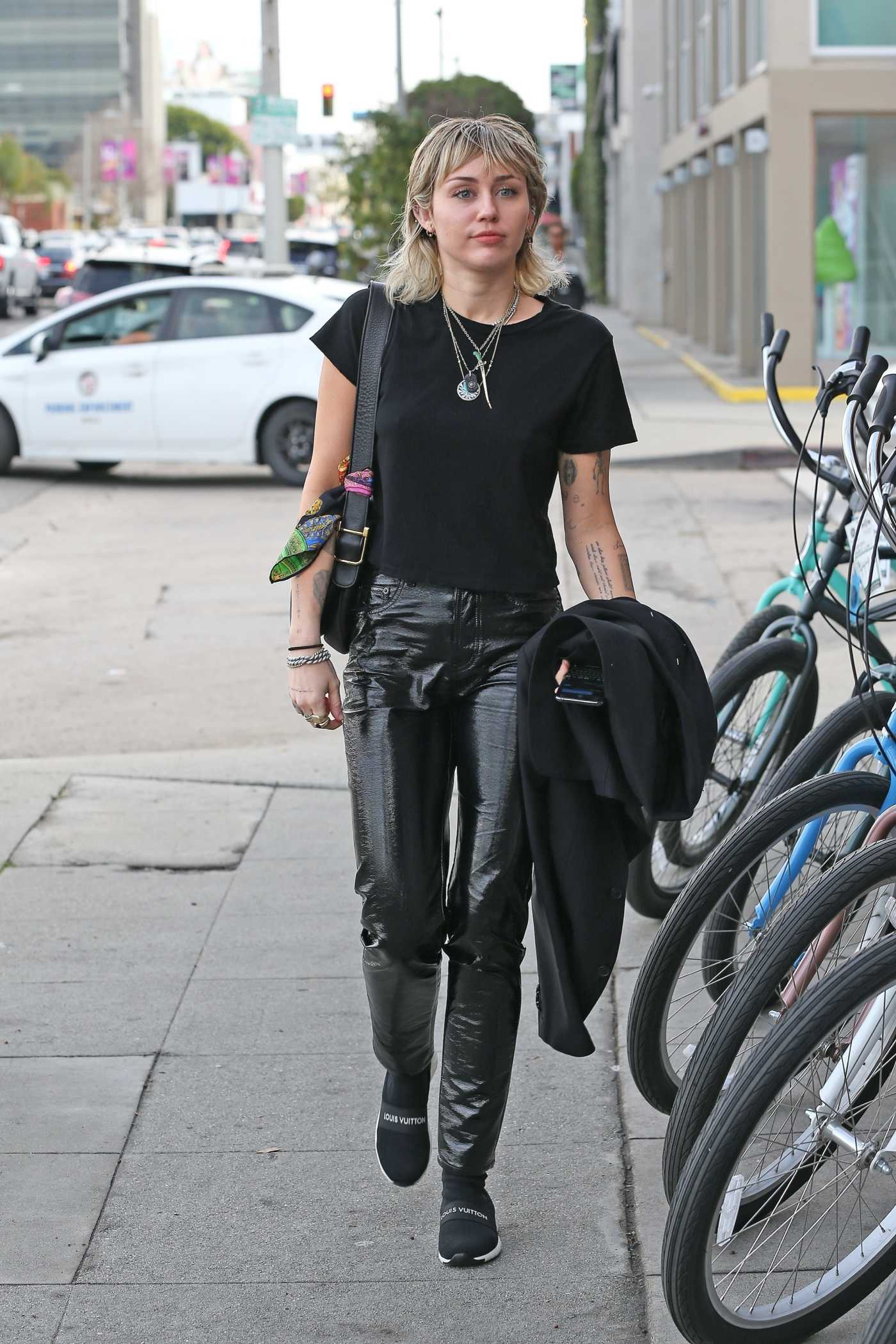 Miley Cyrus in a Black Tee Arrives at a Studio in West Hollywood 01/17/2020