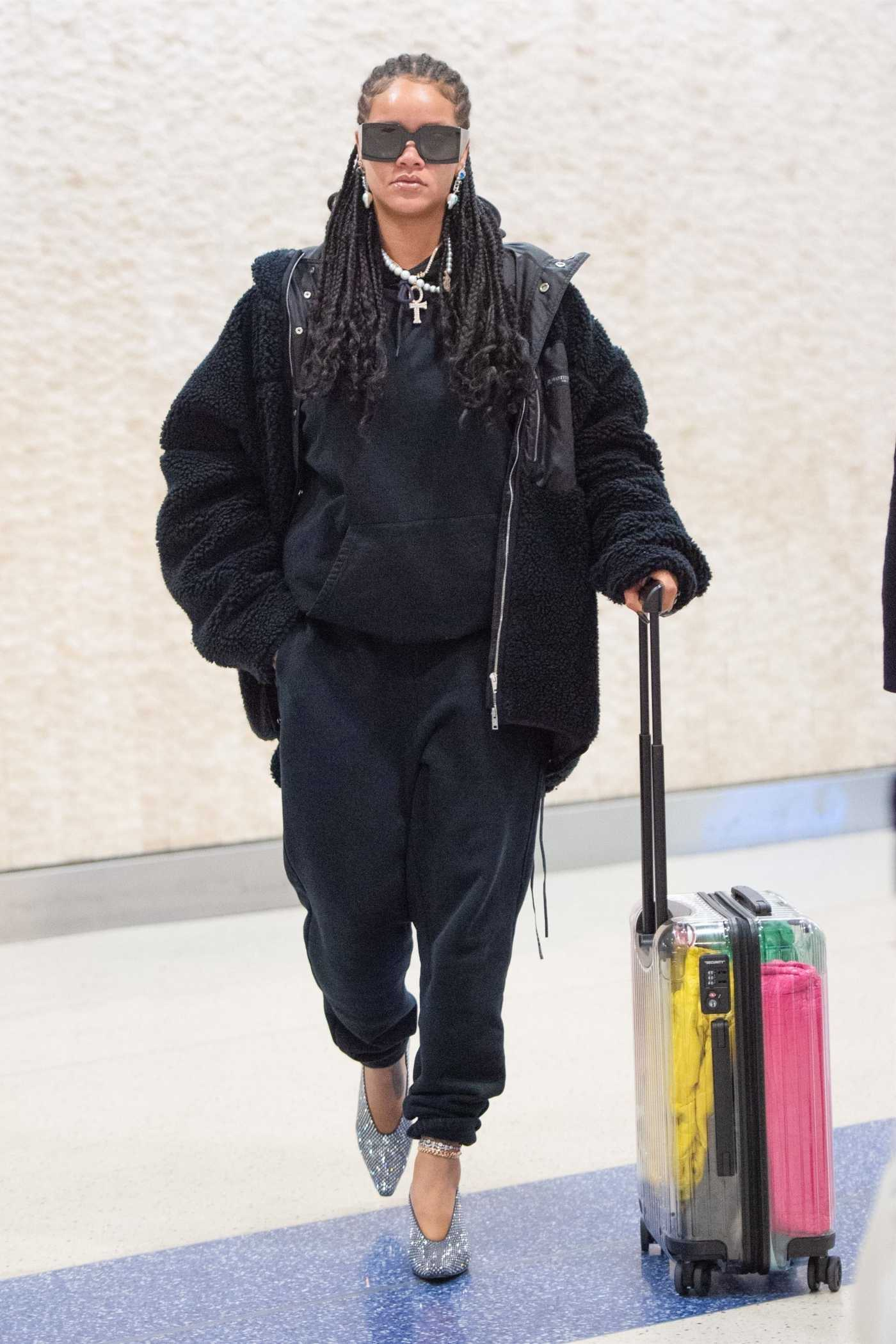 Rihanna in a Black Sweatsuit Arrives at JFK Airport in New York City 01/16/2020