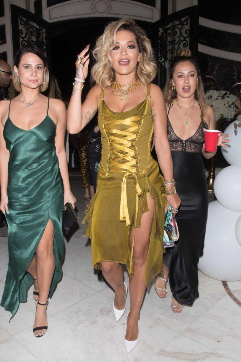 Rita Ora in a Gold Dress