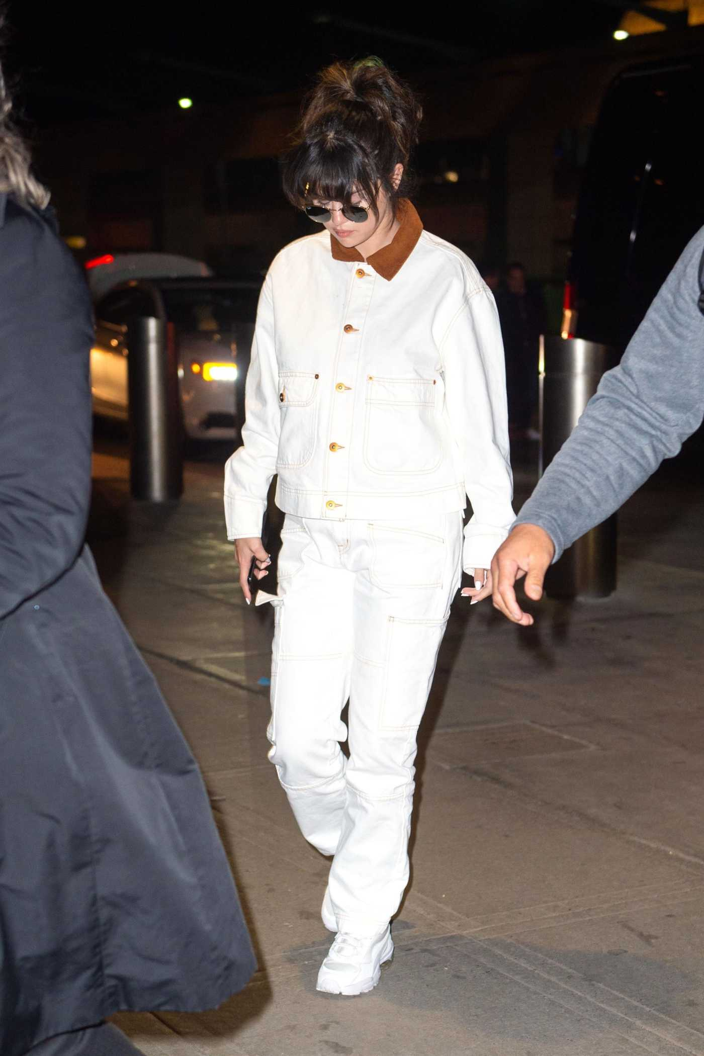 Selena Gomez in a White Suit Arrives at JFK Airport in New York 01/15/2020