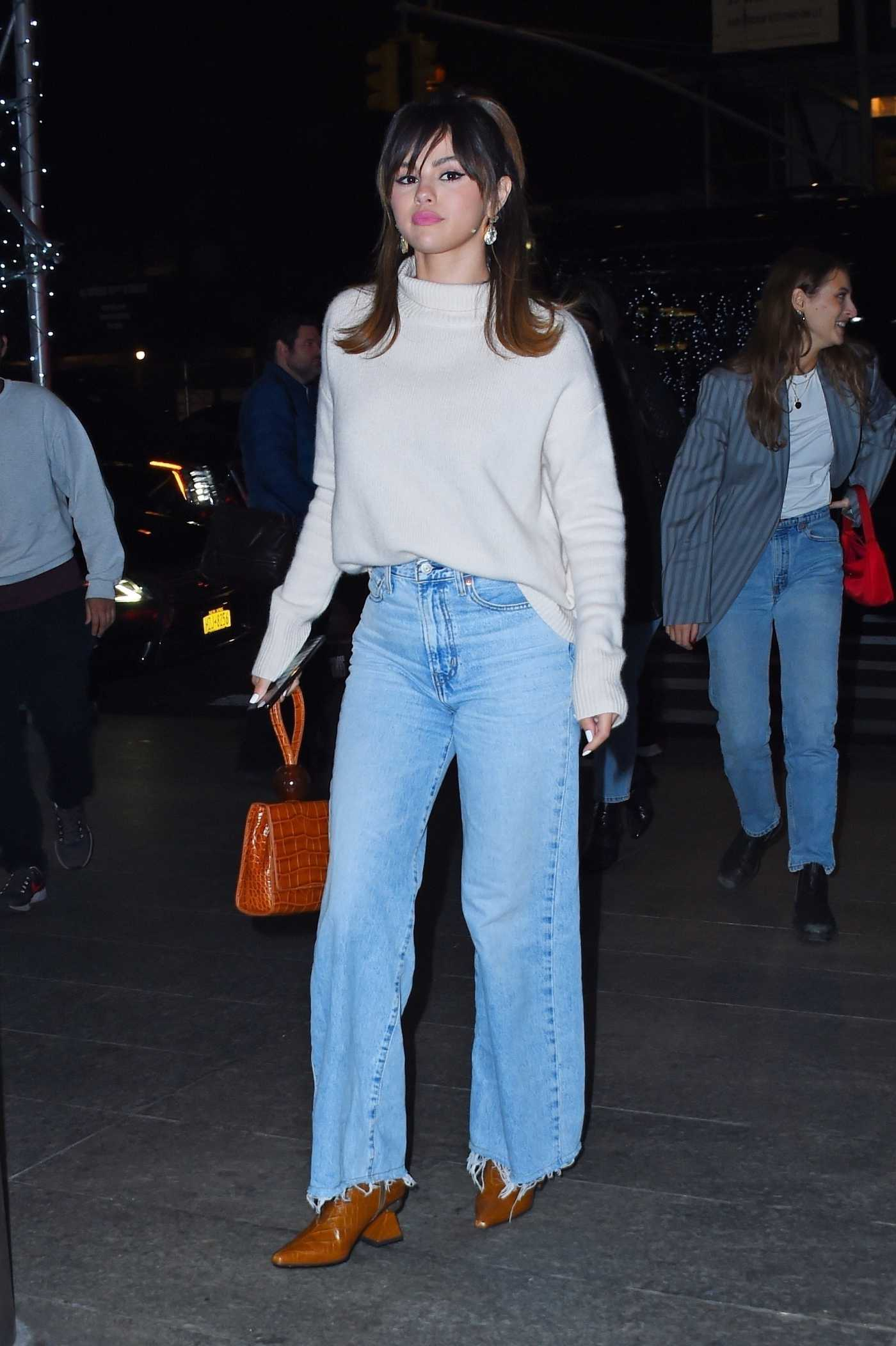 Selena Gomez in a White Sweater Steps Out for Dinner at Nobu Restaurant in New York 01/13/2020