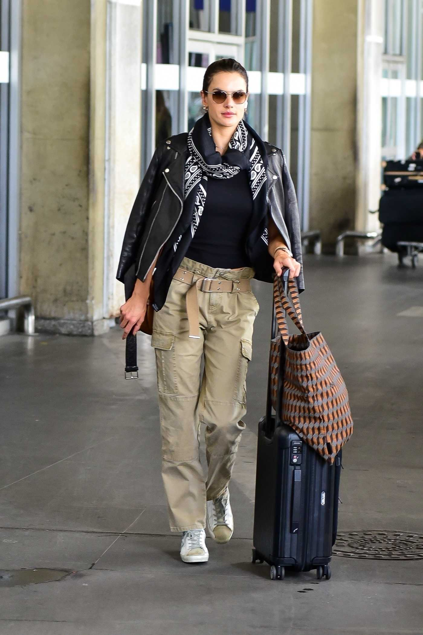 Alessandra Ambrosio in a Beige Pants Arrives at Airport in Sao Paulo 02/22/2020