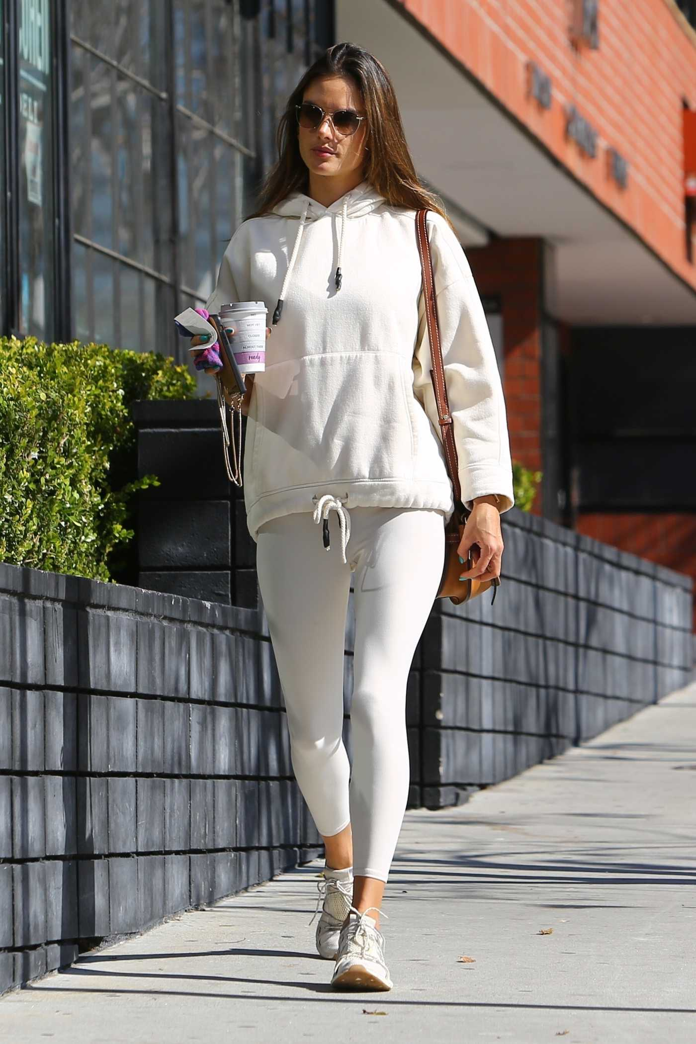 Alessandra Ambrosio in a White Leggings Arrives at a Pilates Studio in Los Angeles 02/20/2020