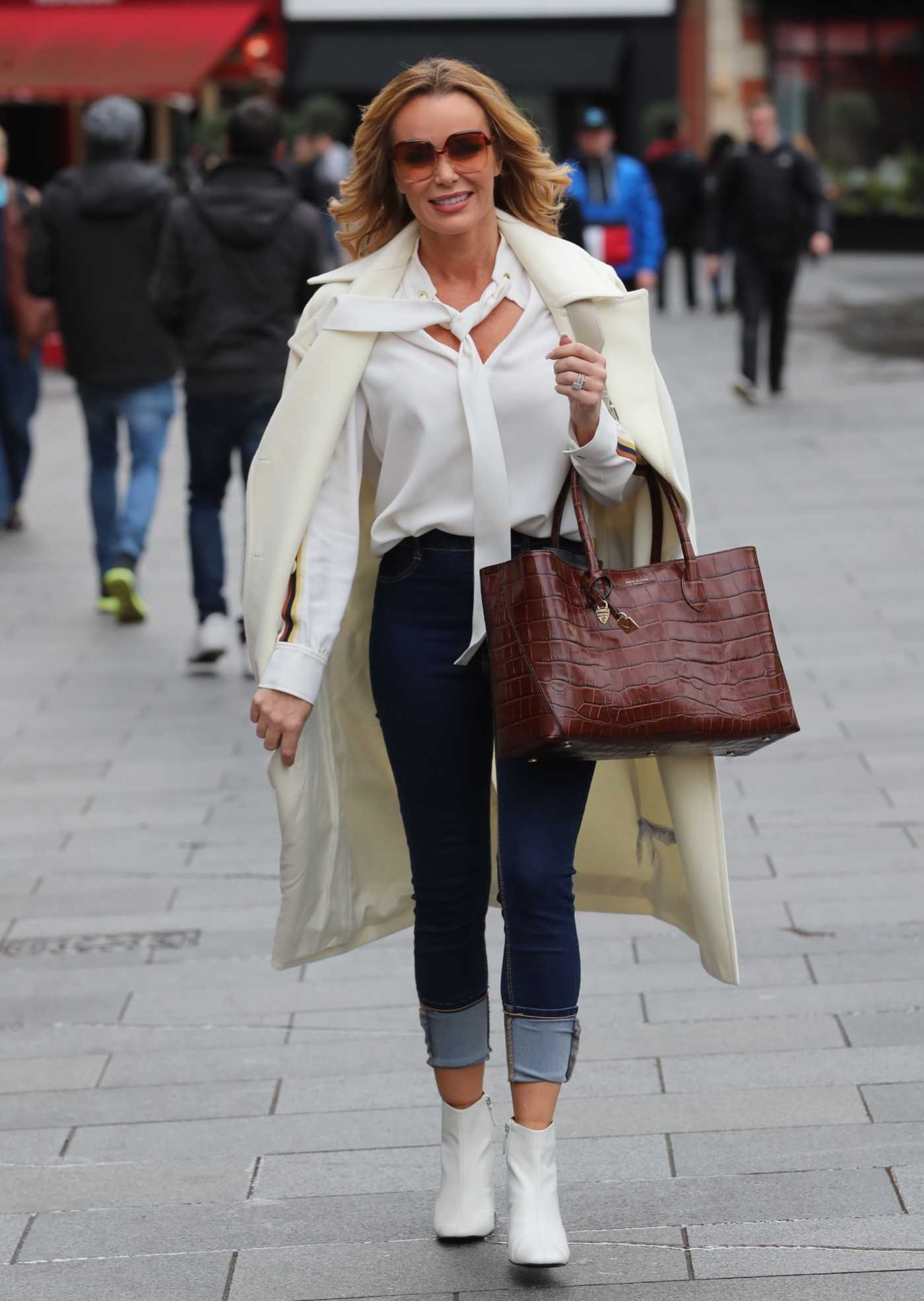 Amanda Holden in a White Coat Exits the Heart Radio in London 01/31/2020