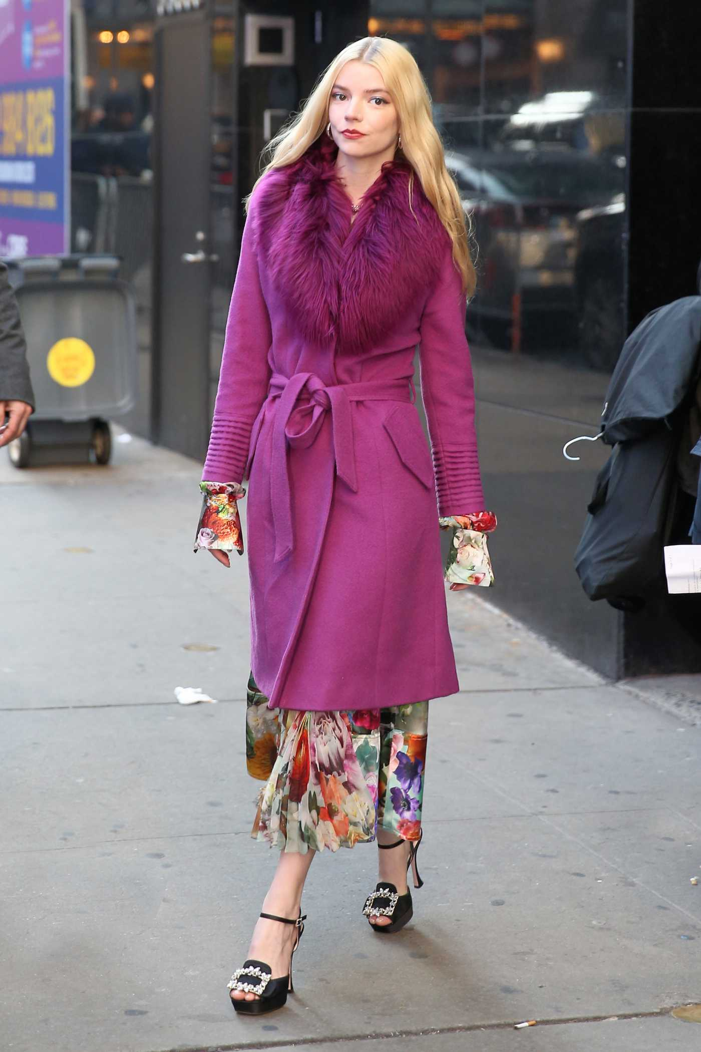 Anya Taylor-Joy in a Purple Coat Leaves Good Morning America in New York City 02/17/2020