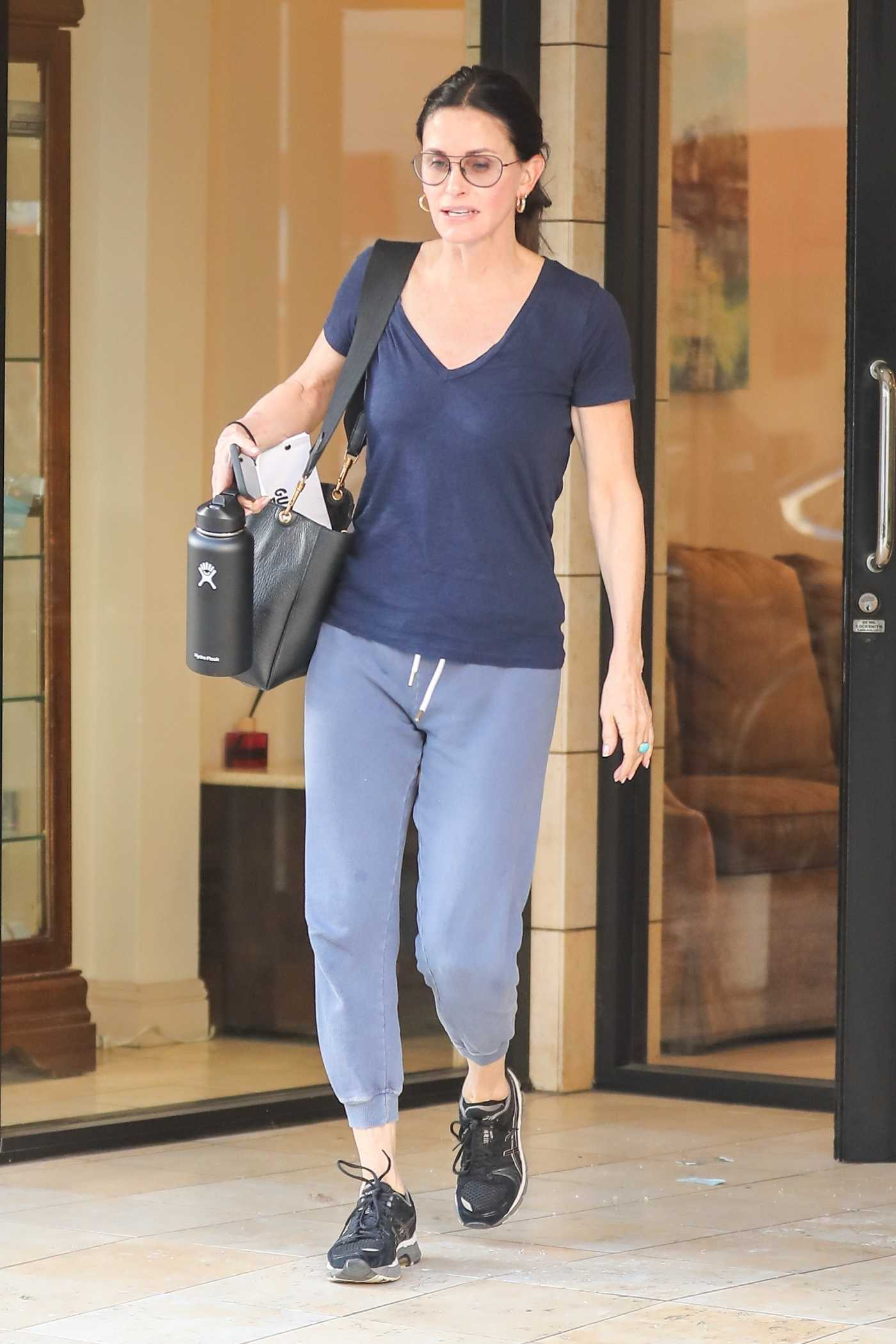 Courteney Cox in a Blue Tee Leaves a Beverly Hills Spa in LA 02/25/2020