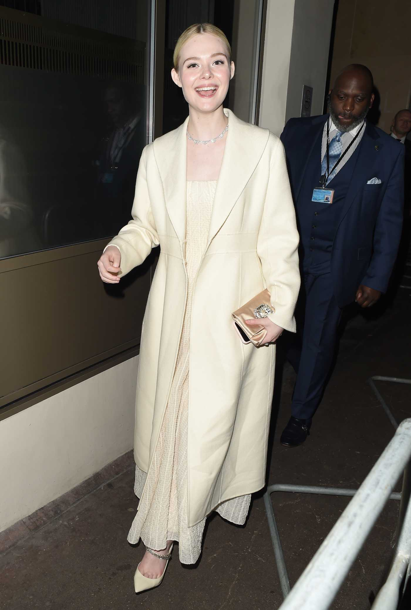 Elle Fanning in a Beige Coat Leaves the London Critics' Circle Film Awards in London 01/30/2020