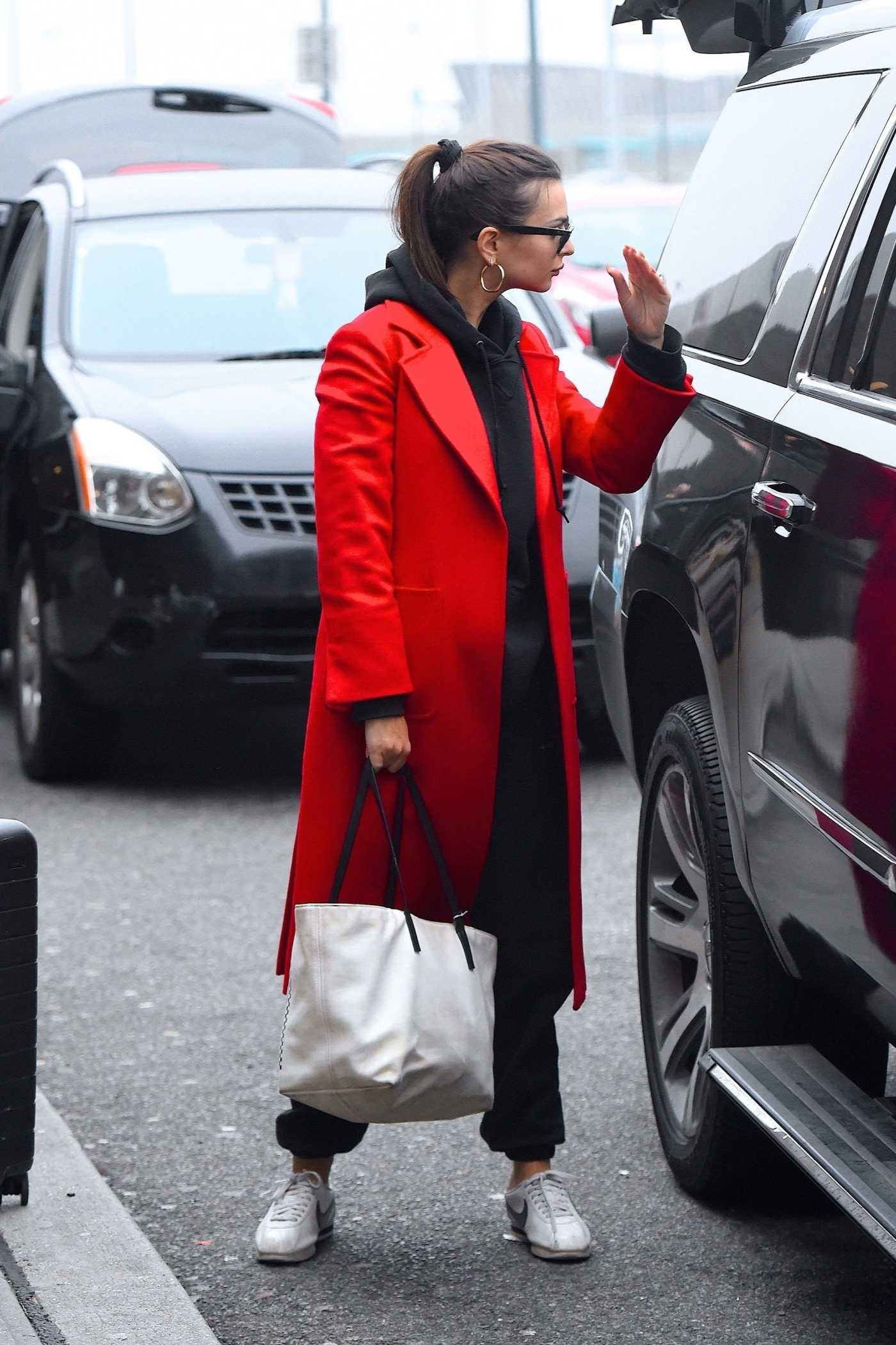 Emily Ratajkowski in a Red Coat Arrives at JFK Airport in New York 02/18/2020
